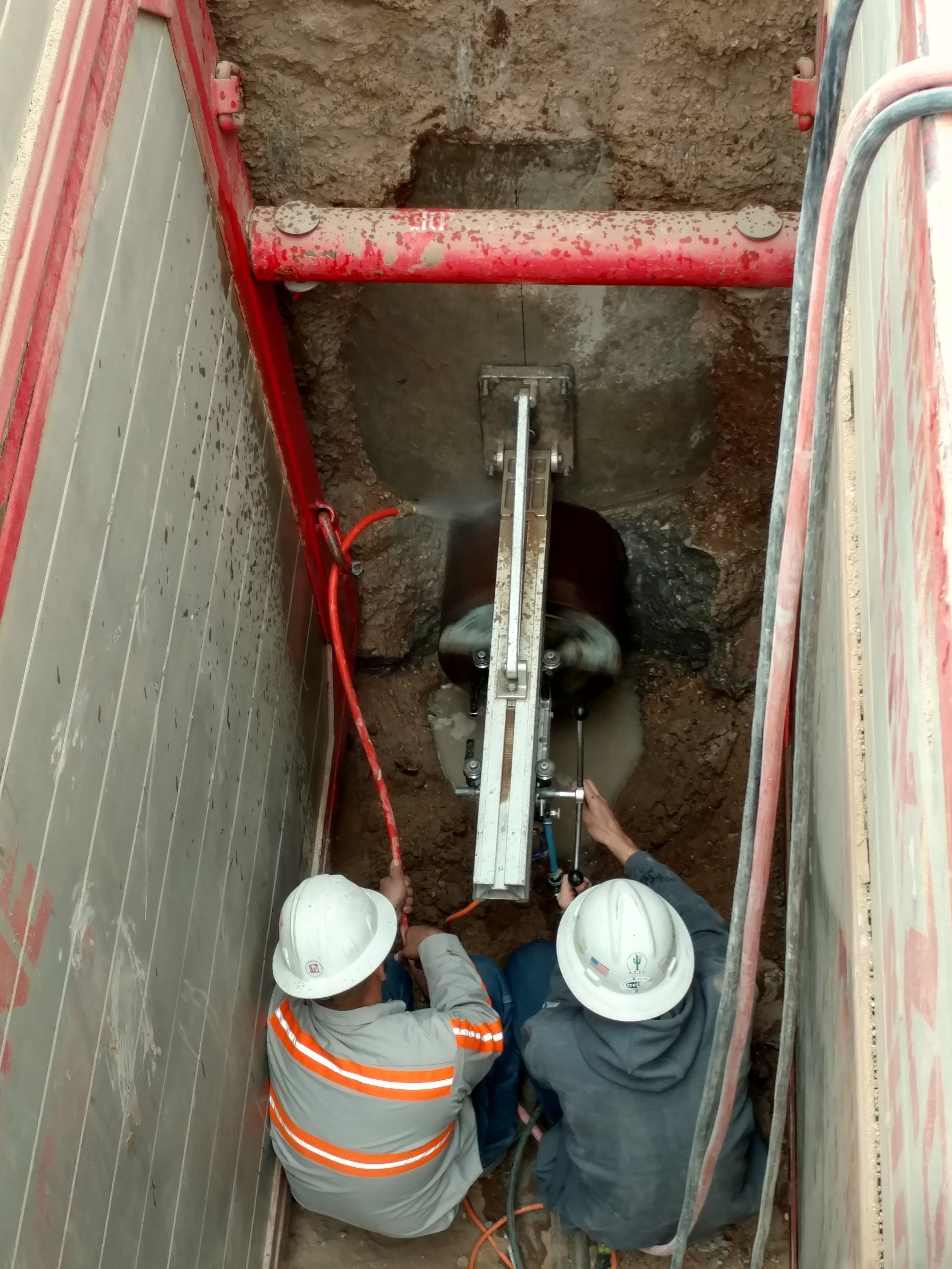 Crew hard at work near a manhole
