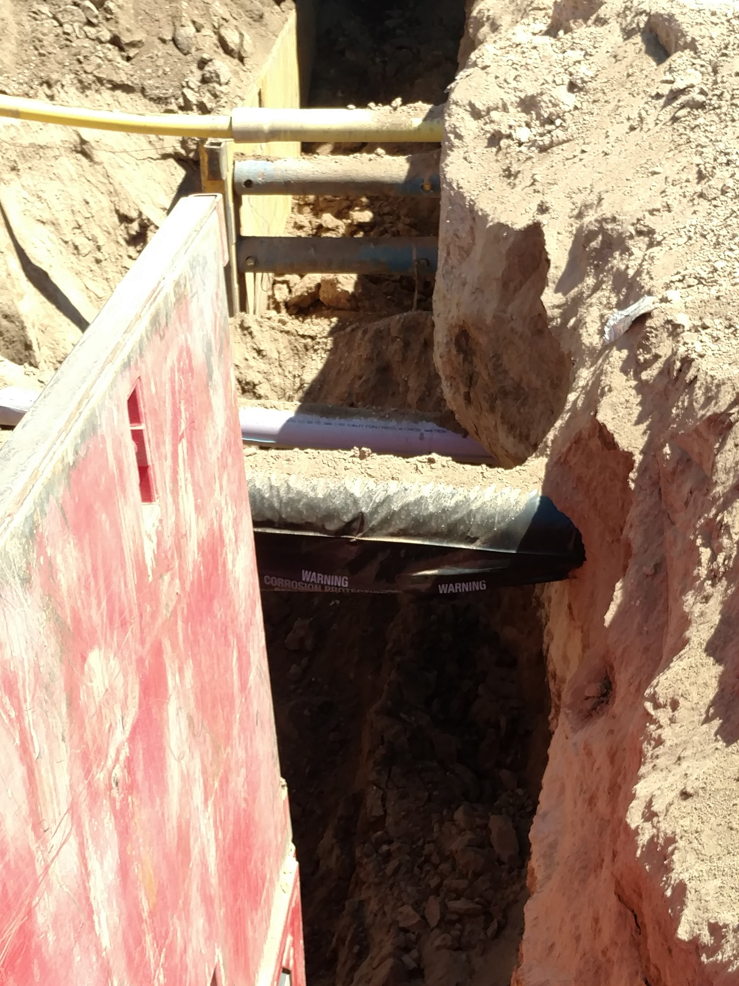 Crossing the sewer line under existing utilities
