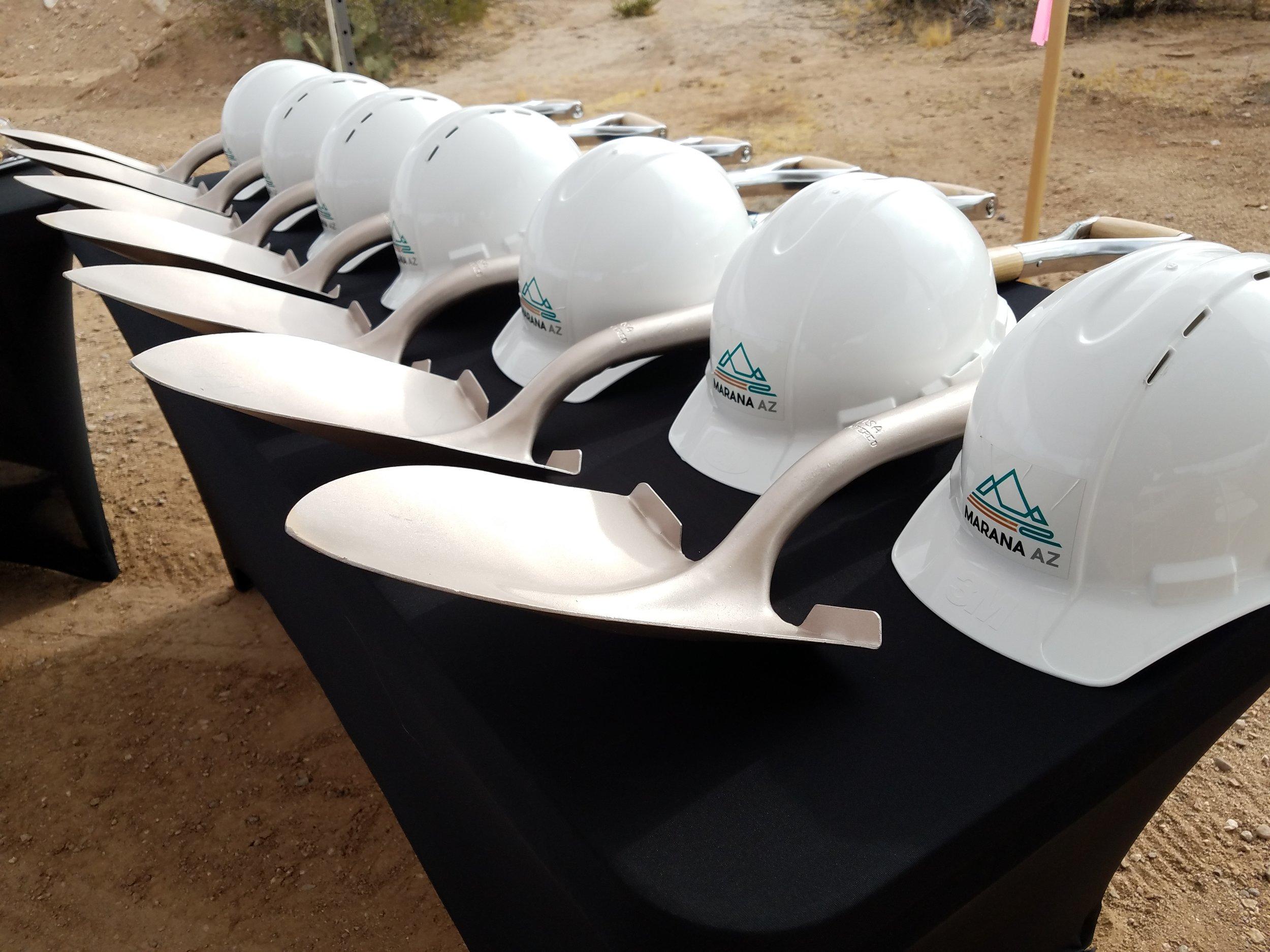Ceremonial shovels and hard hats
