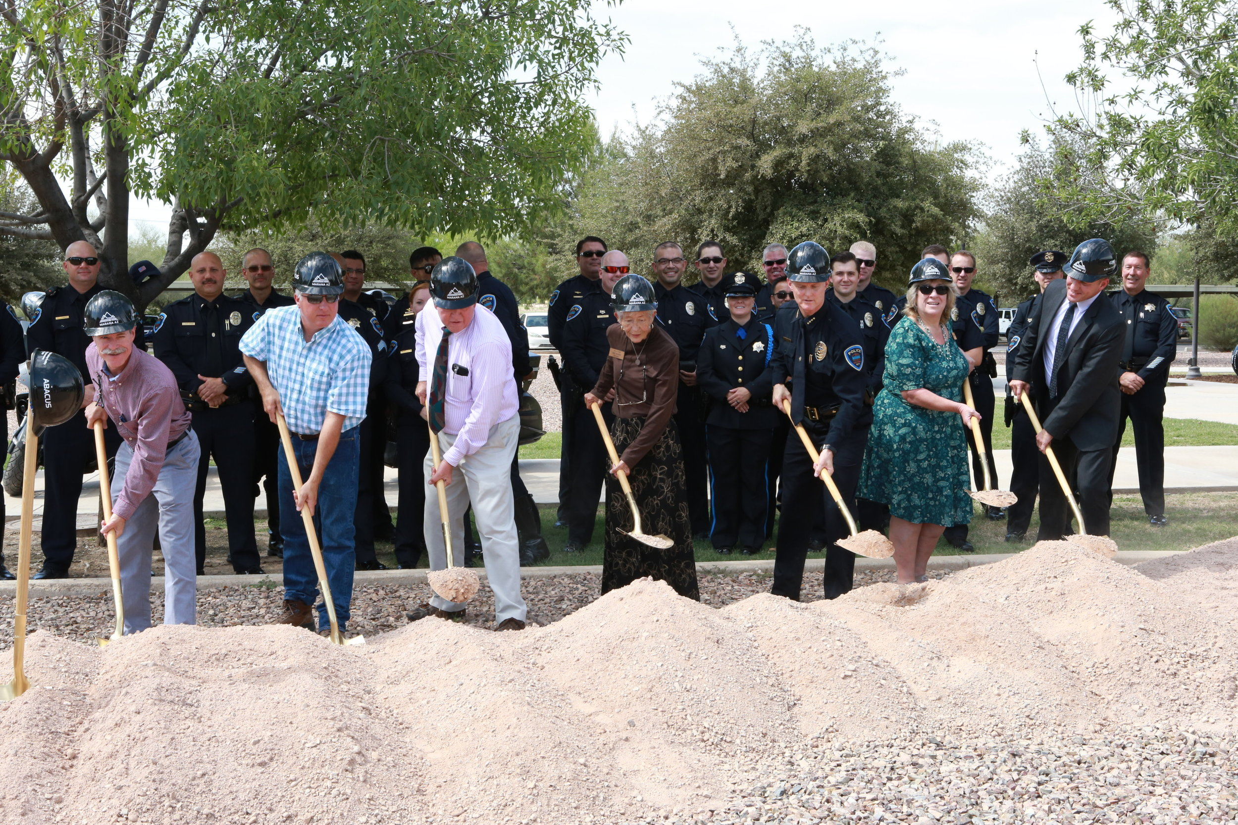 Left to right: Councilmember Bowen, Vice Mayor Post, Mayor Honea, Councilmember McGorray, Police Chief Rozema, Councilmember Comerford, and Town Manager Gilbert Davidson break ground for the new police facility.