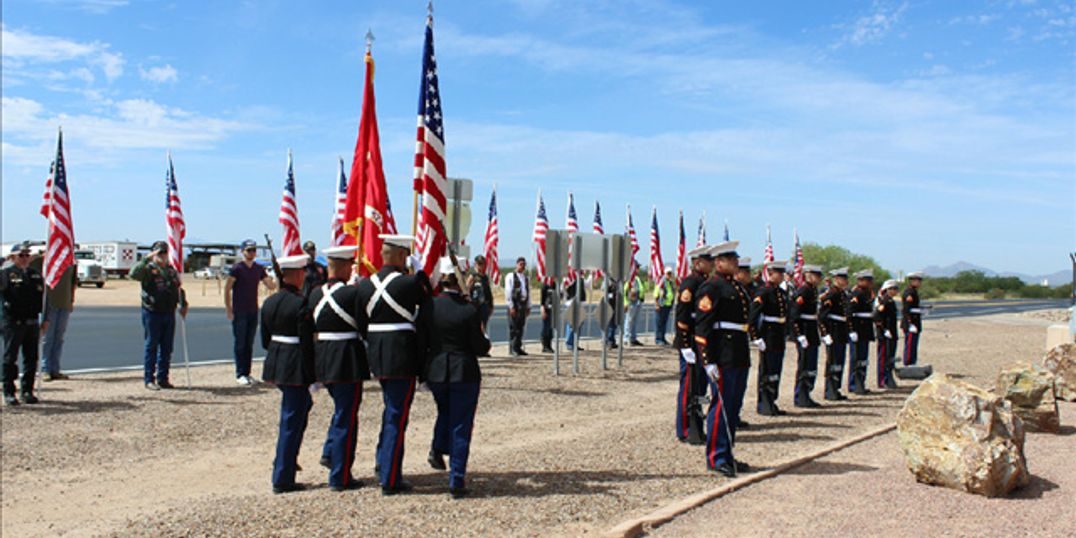 A Marine color guard participates in the ceremony to honor those who perished in the April 8, 2000 crash of a MV-22 Osprey Tilt rotor aircraft at the Marana Regional Airport.