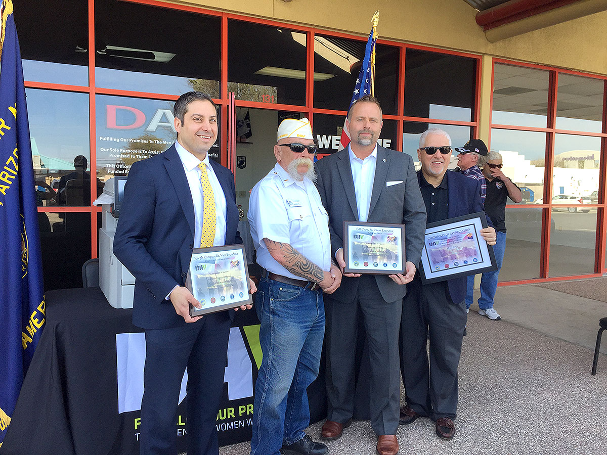 Representatives from Ricoh and the Tucson Disabled American Veterans pose for a photo during the ceremony to celebrate the donation of 15 printers.