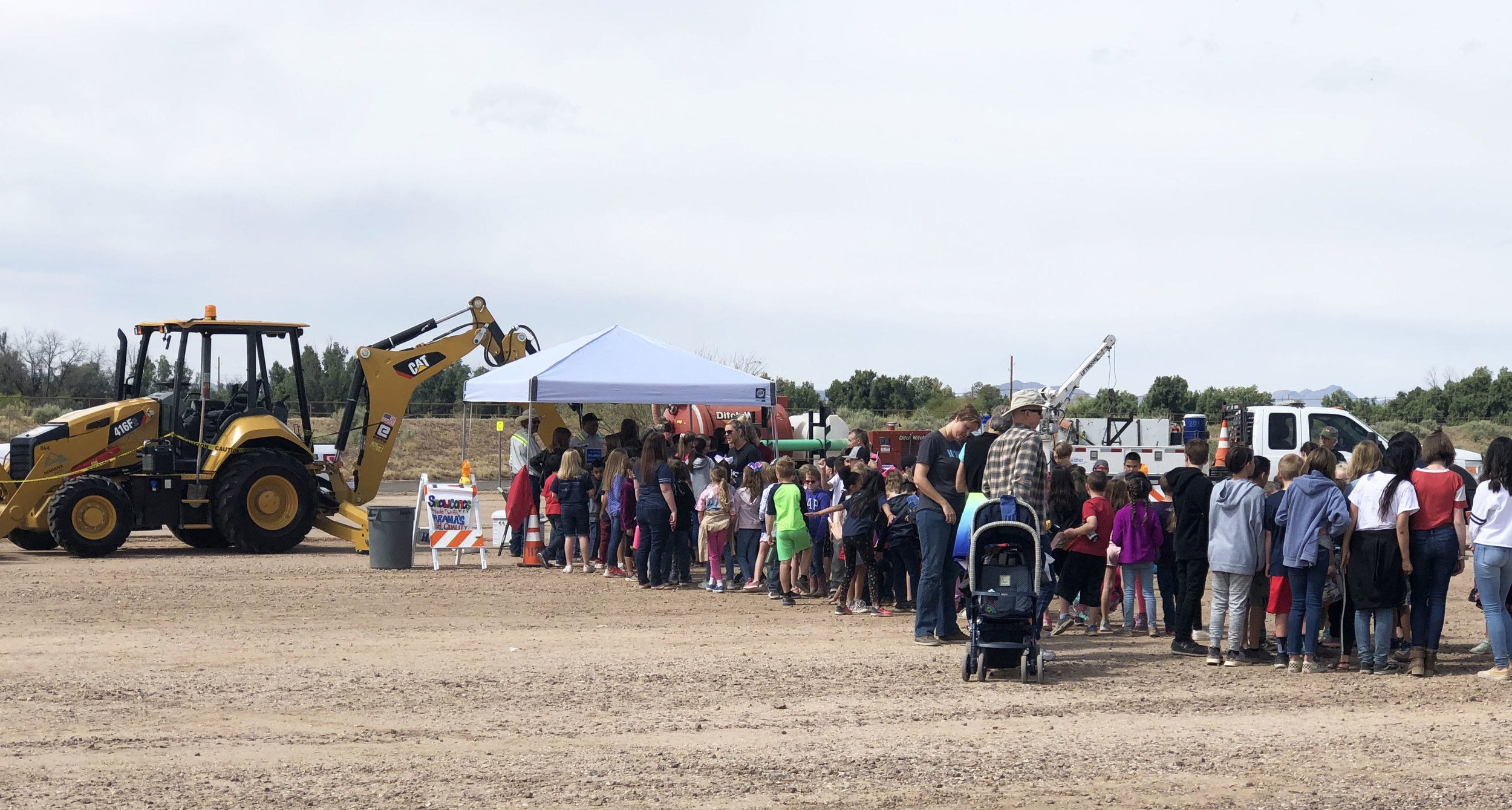Marana Water were giving away free snow cones that attracted a long line.