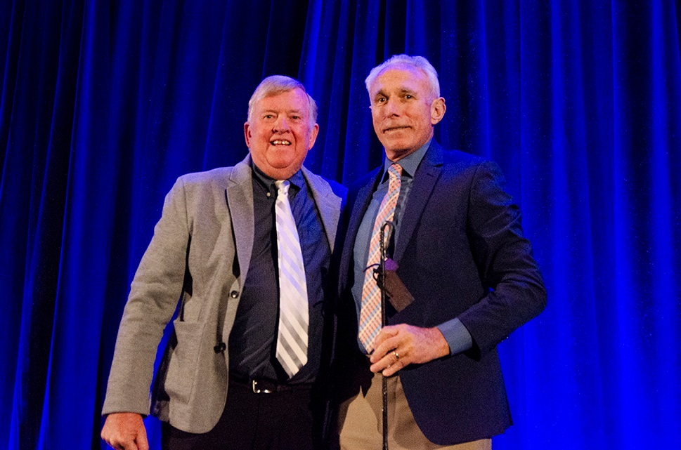 Ed Stolmaker receives the Branding Iron Award from Mayor Honea on the 2019 State of the Town stage.