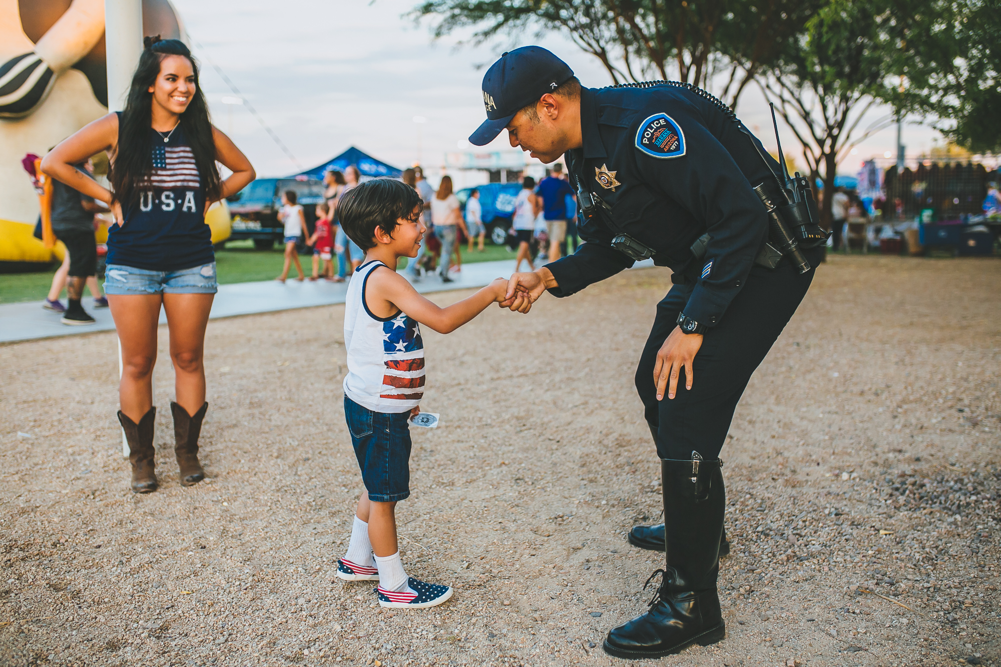 Police officer greeting child at Star Spangled Spectacular