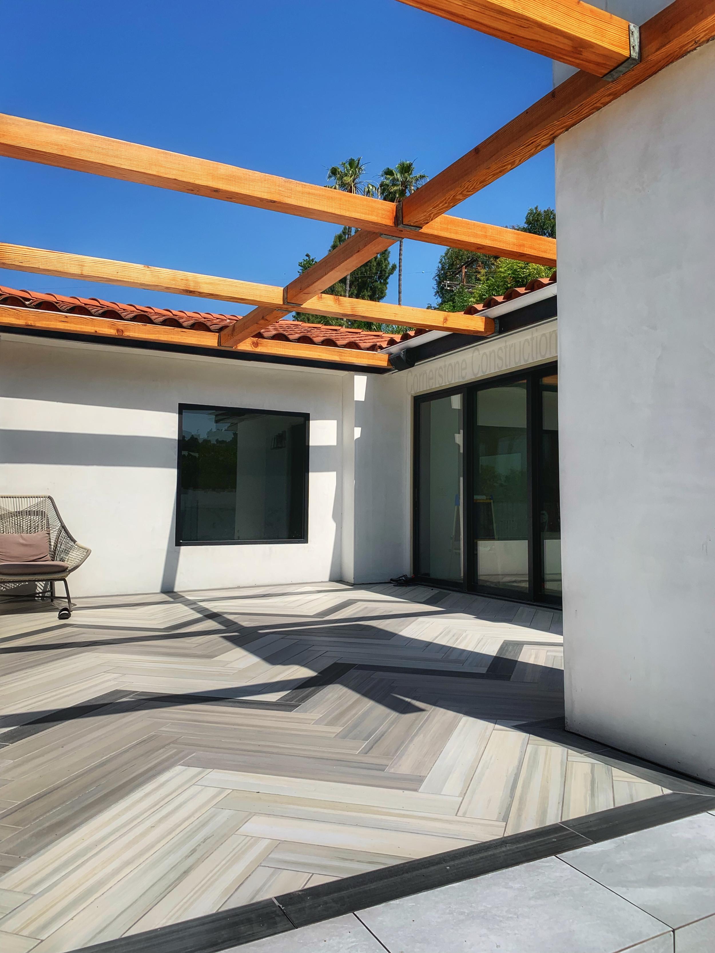 gradient herringbone tile in patio