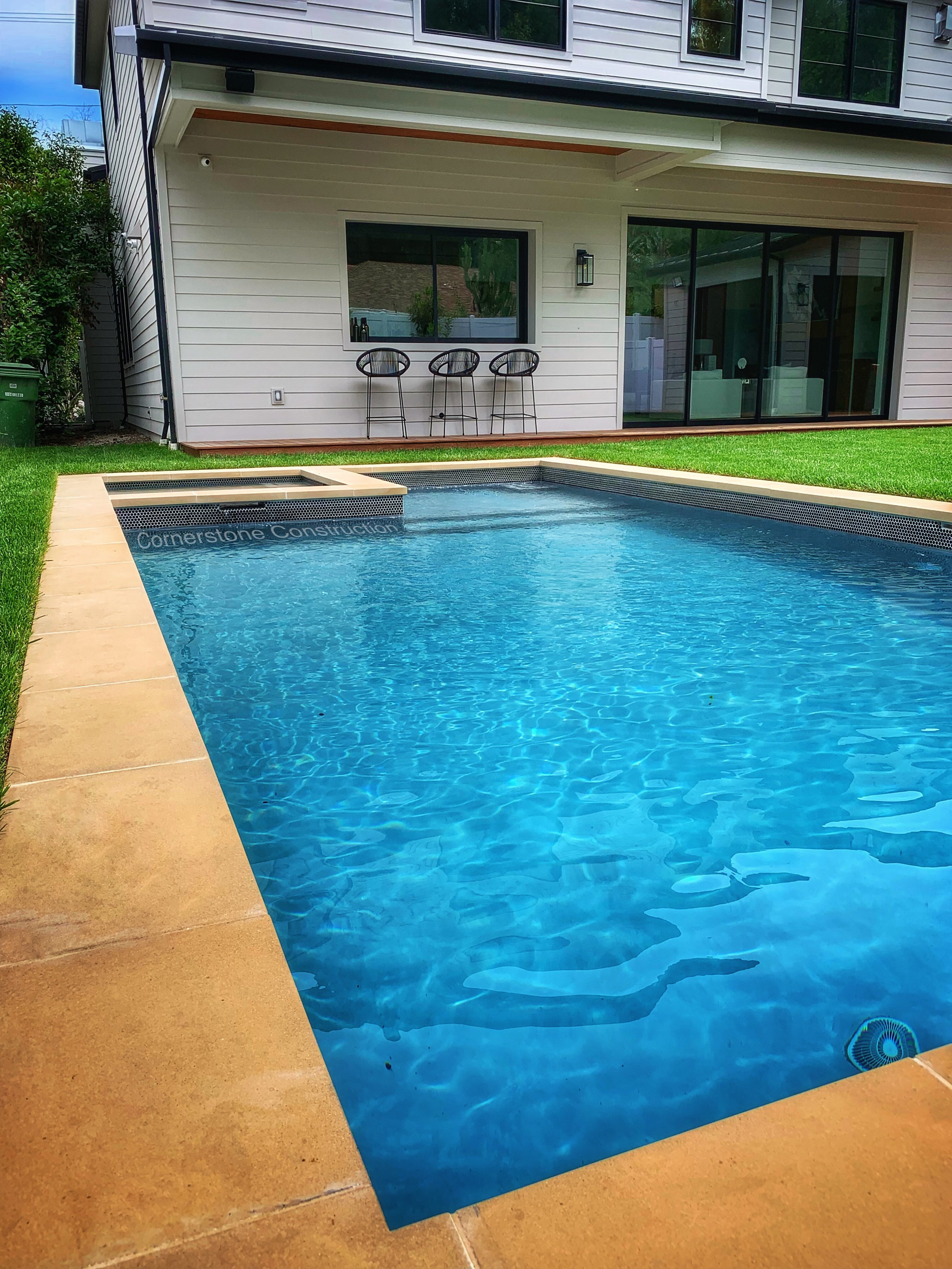 rectangular pool with spa inside
