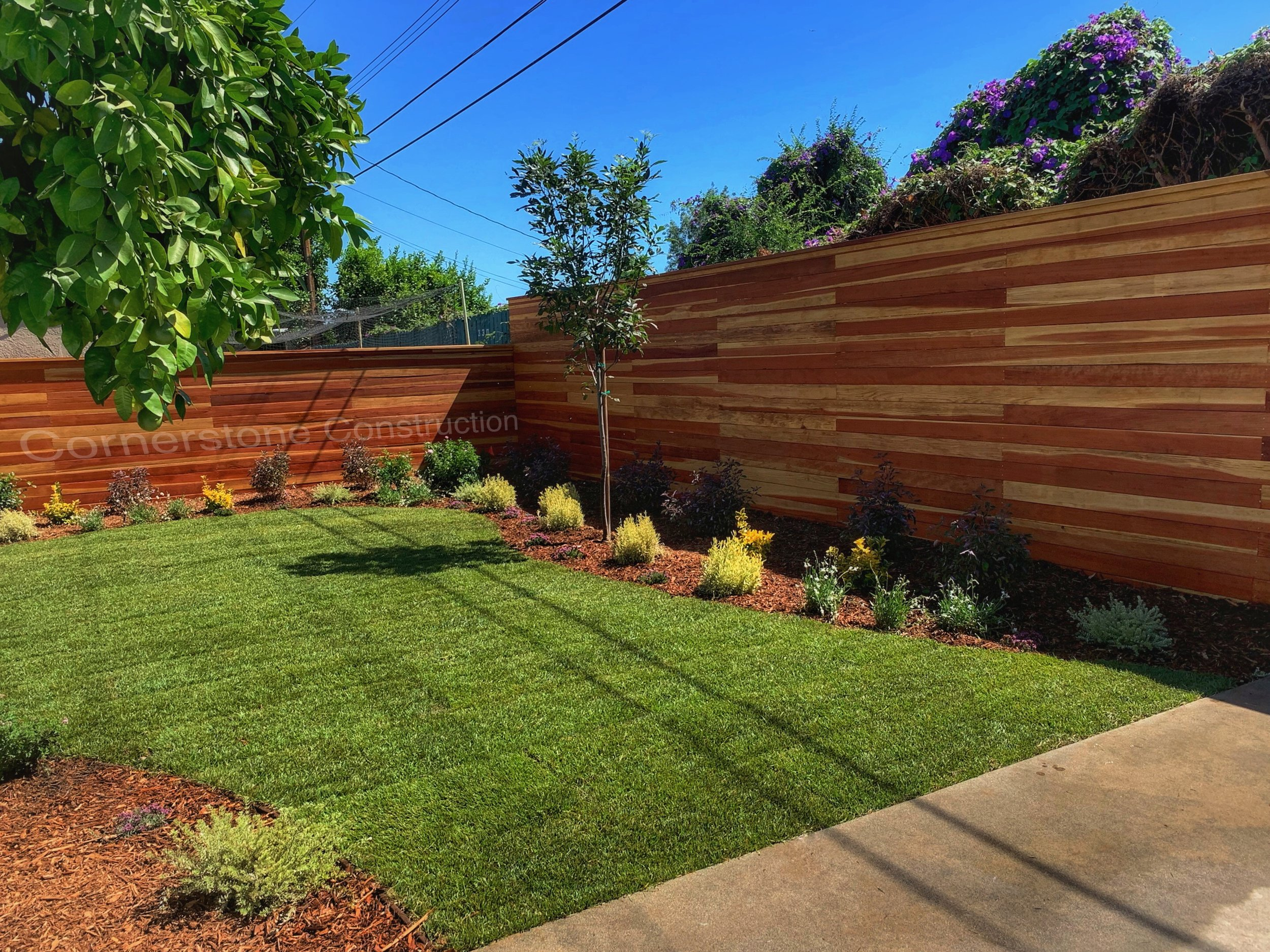 artificial turf and wooden fencing