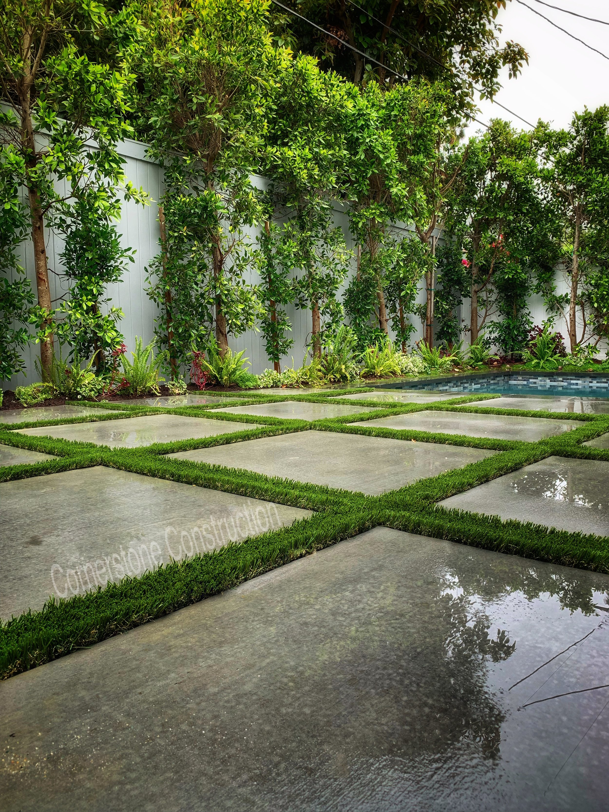 giant concrete with grass pavers in backyard