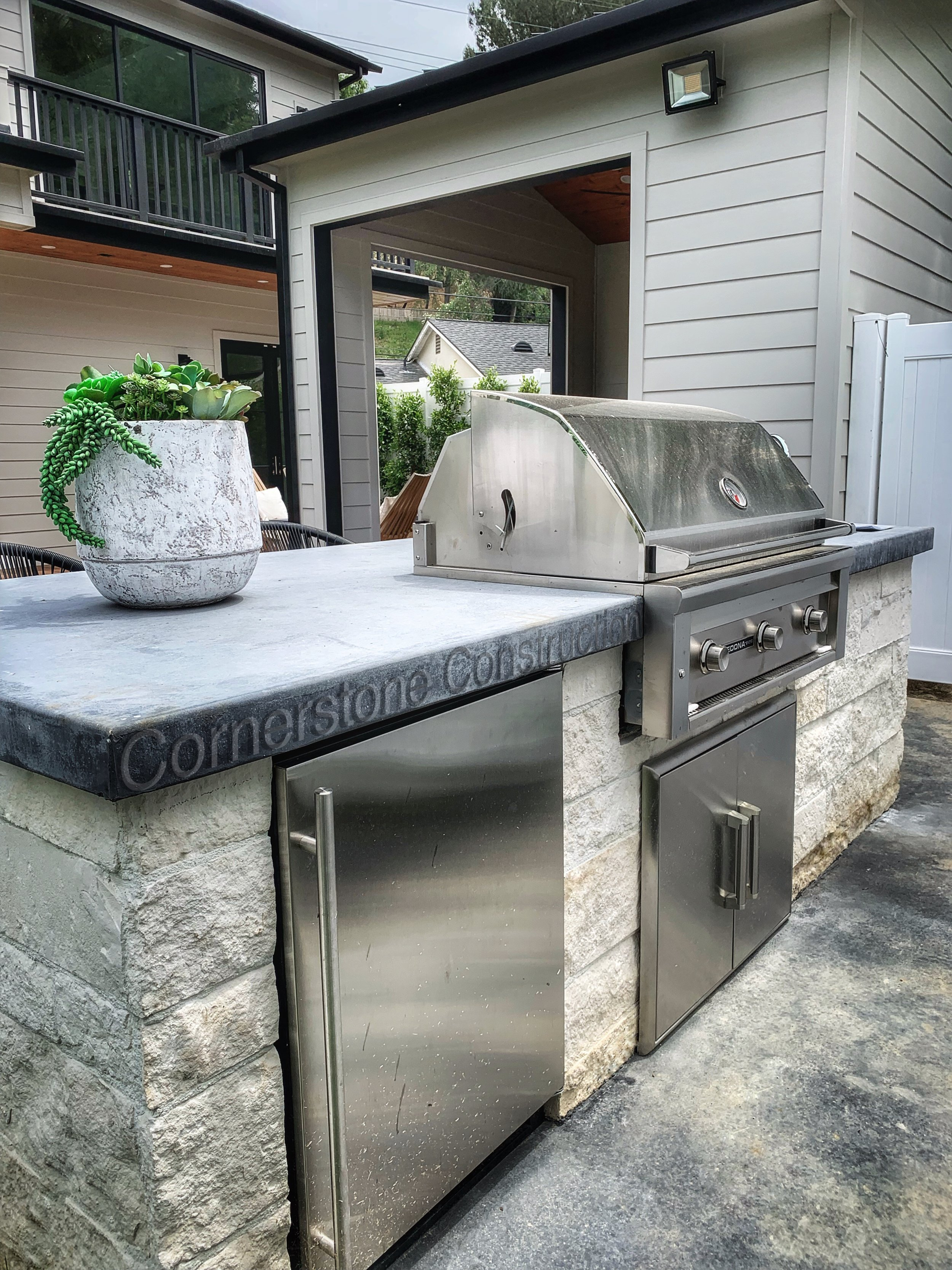 built-in grill and mini-fridge with granite countertop