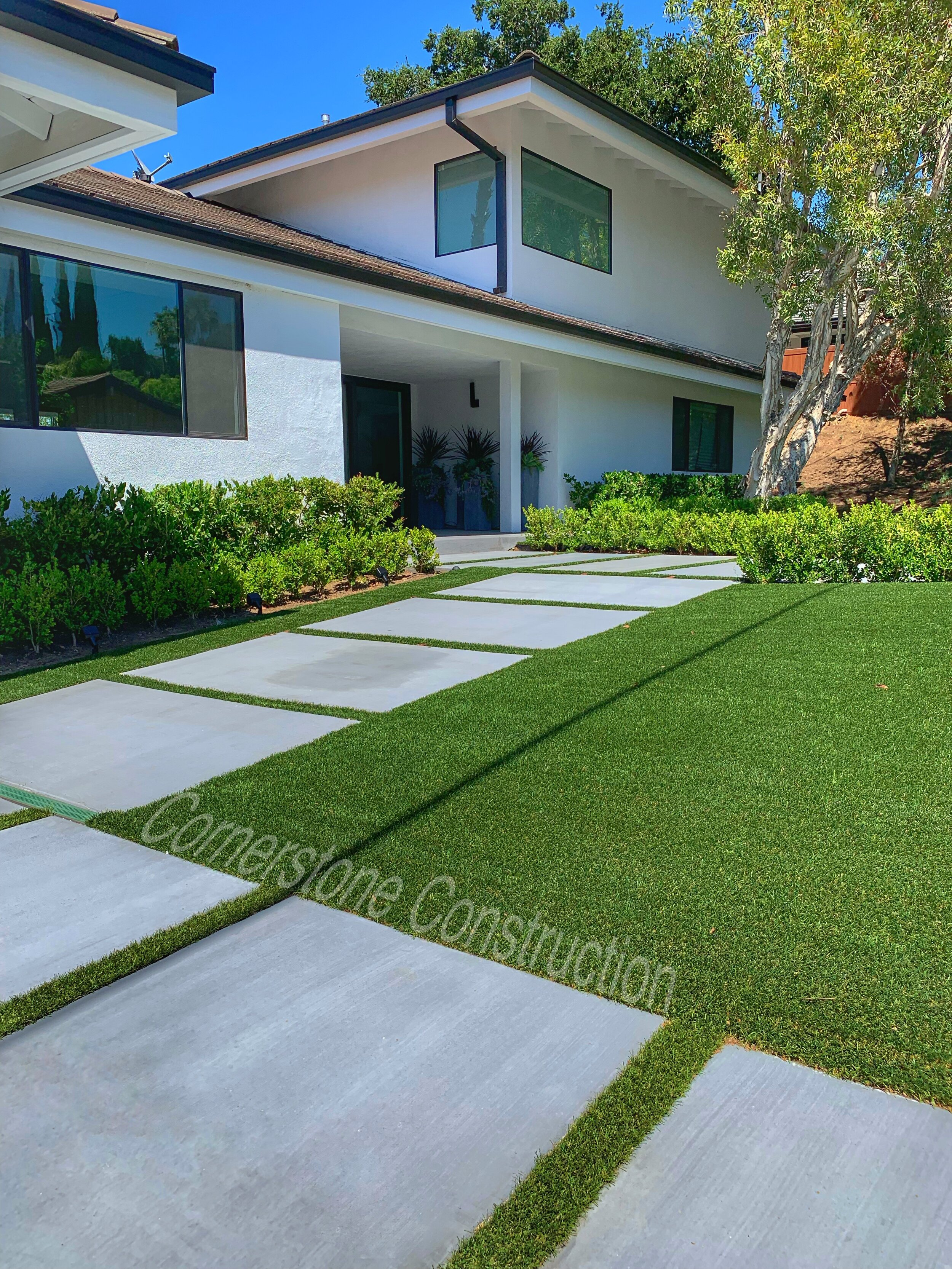 pavers and grass walkway in front yard