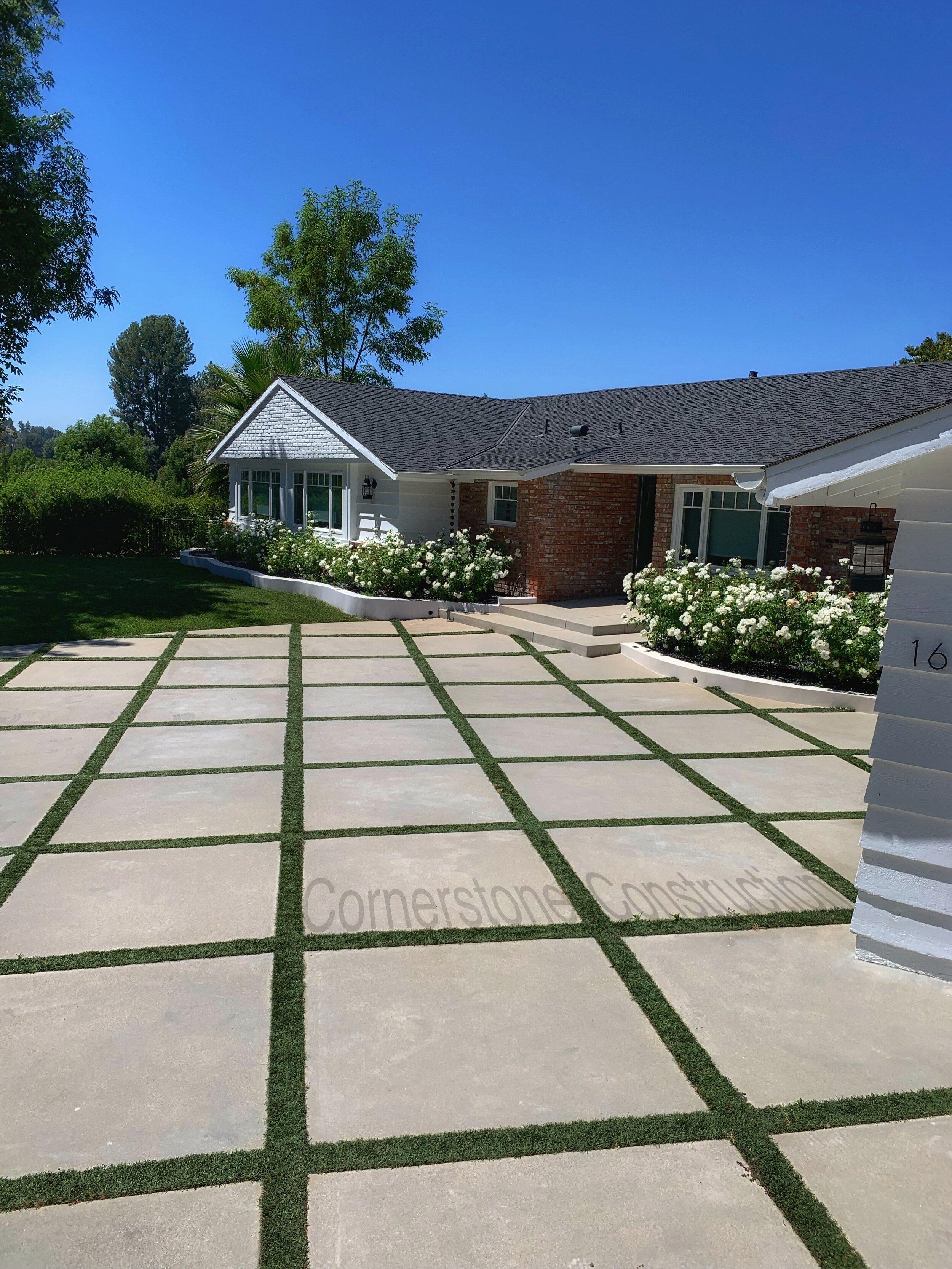 grass and concrete pavers driveway