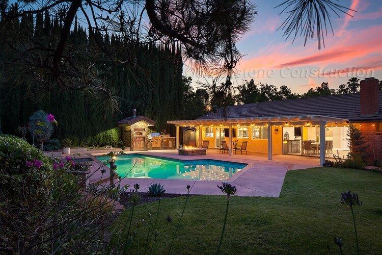 pool, grill, and California room in backyard