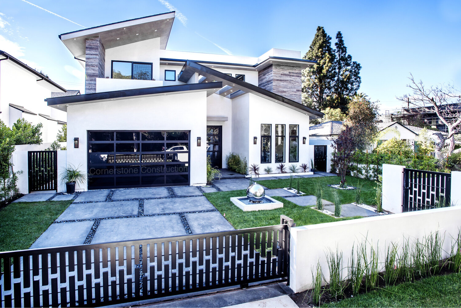 giant concrete pavers and gross driveway with metal gate