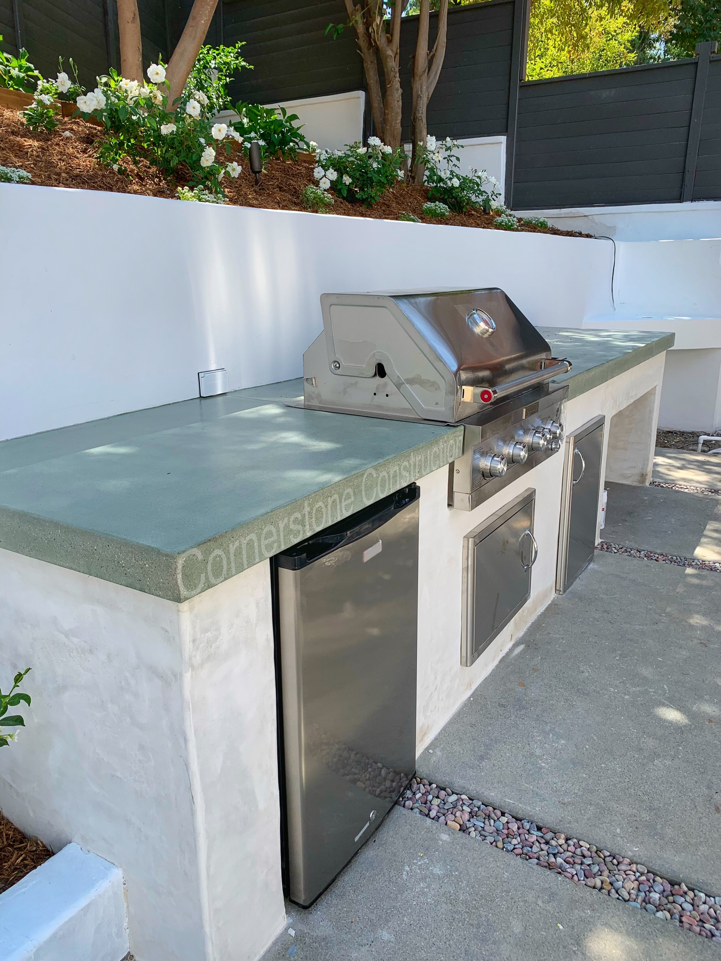 basic build-in grill and mini-fridge in backyard