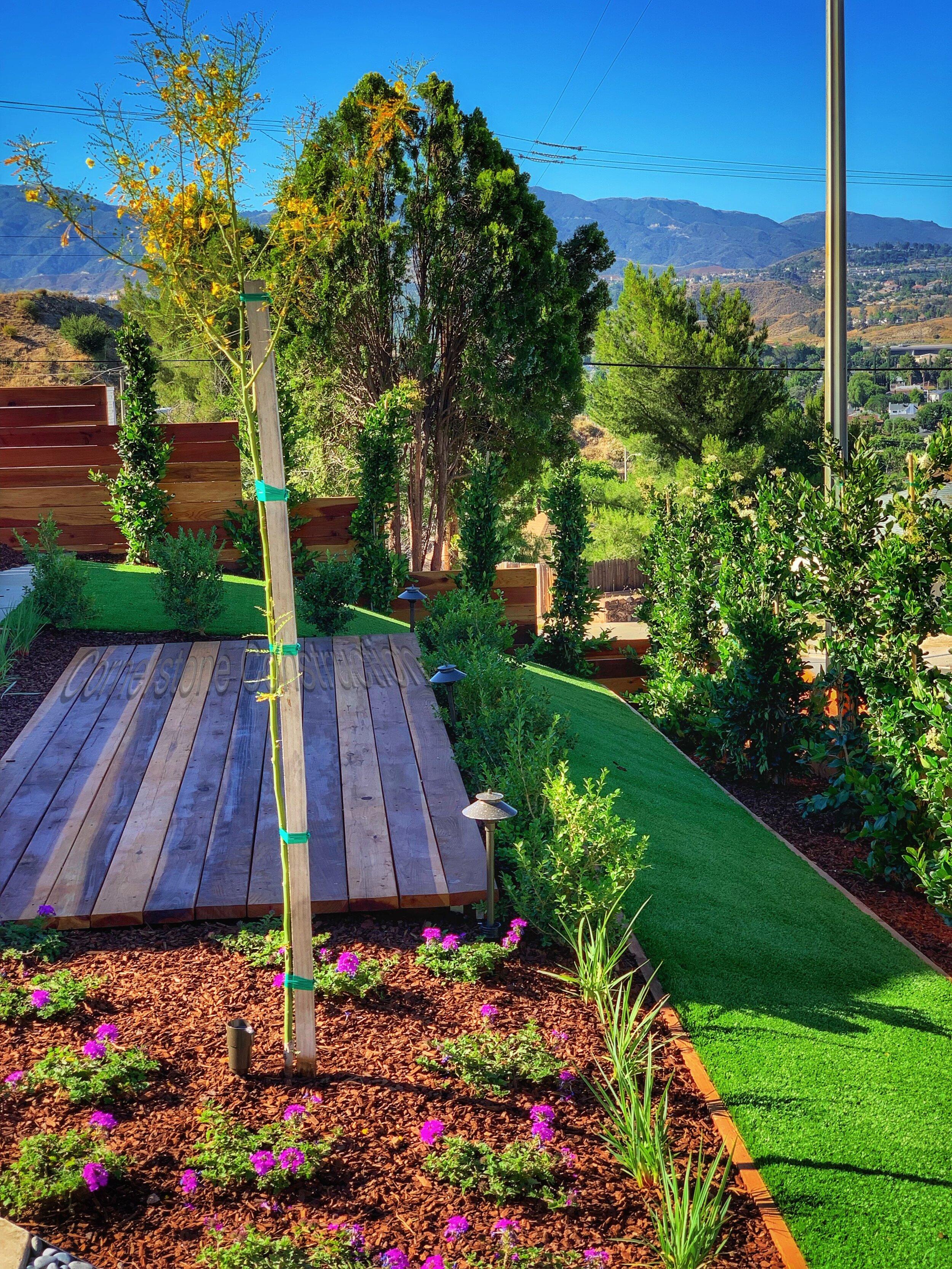 deck on hill in backyard