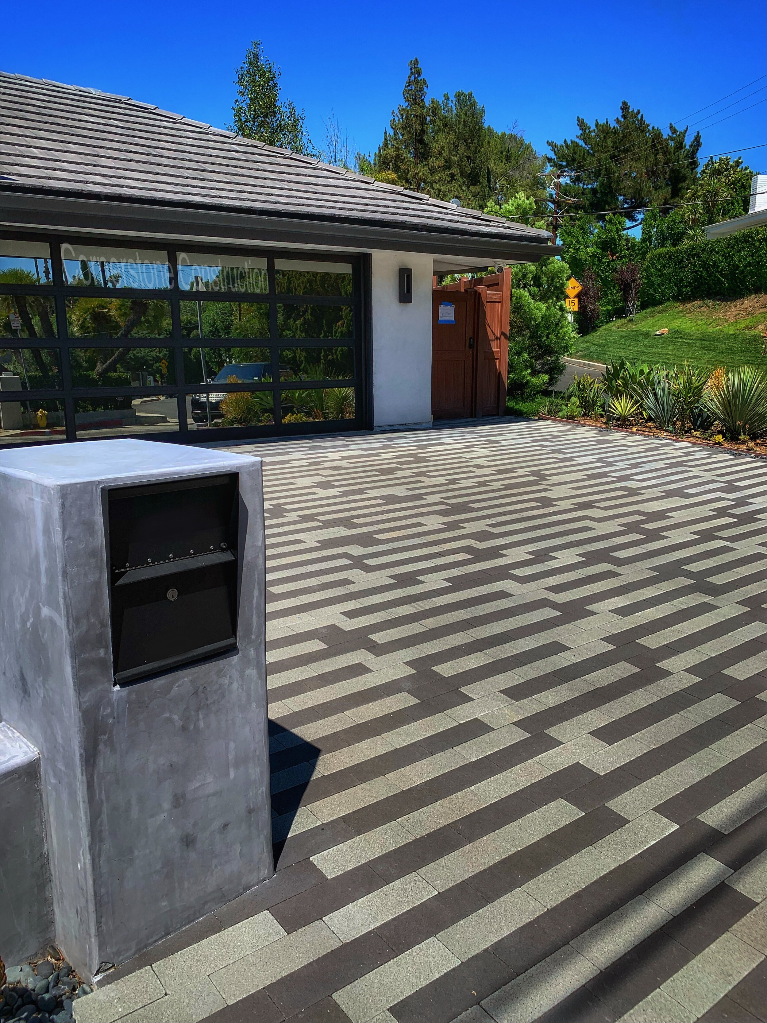 patterned stone pavers in driveway