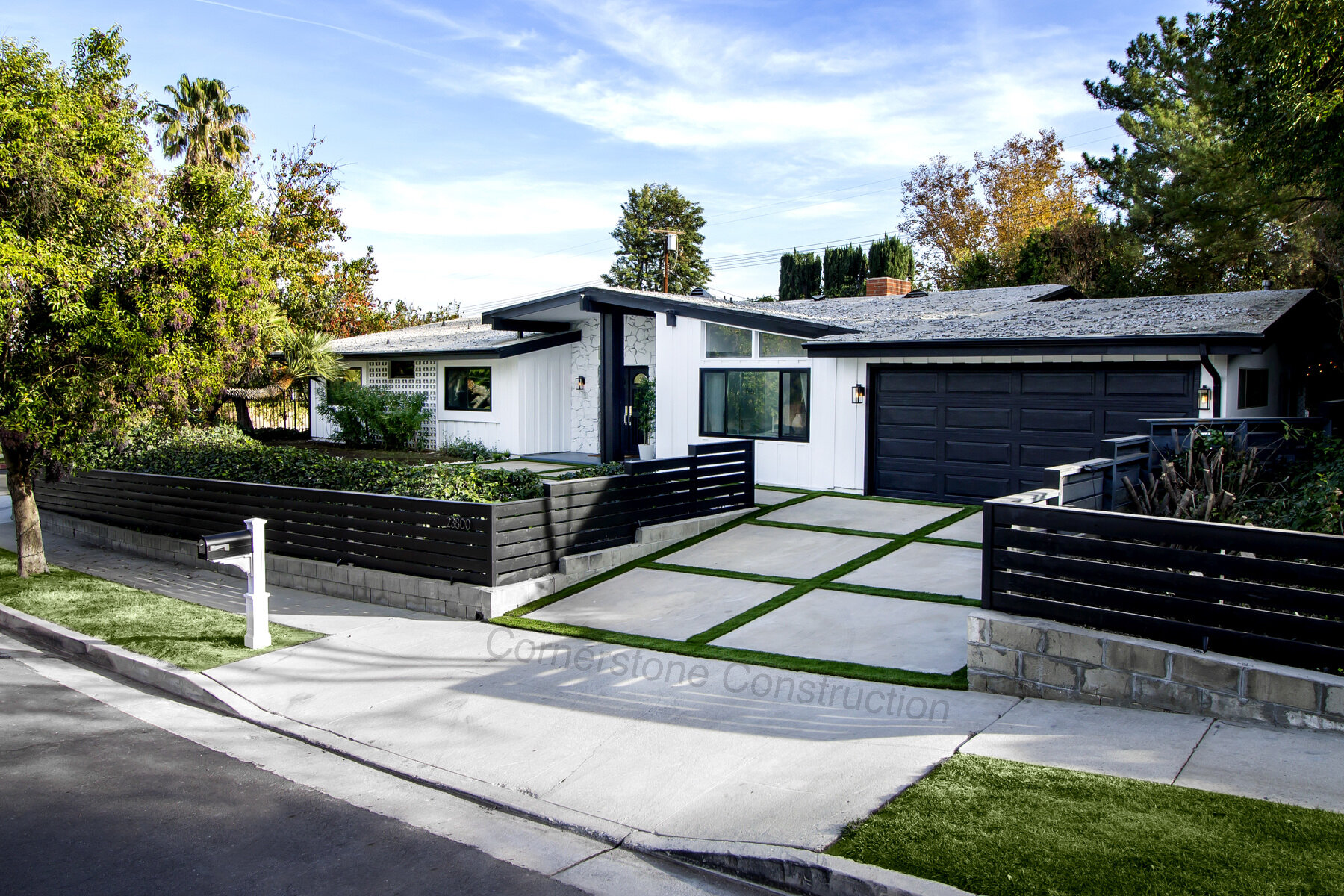 giant pavers with grass driveway