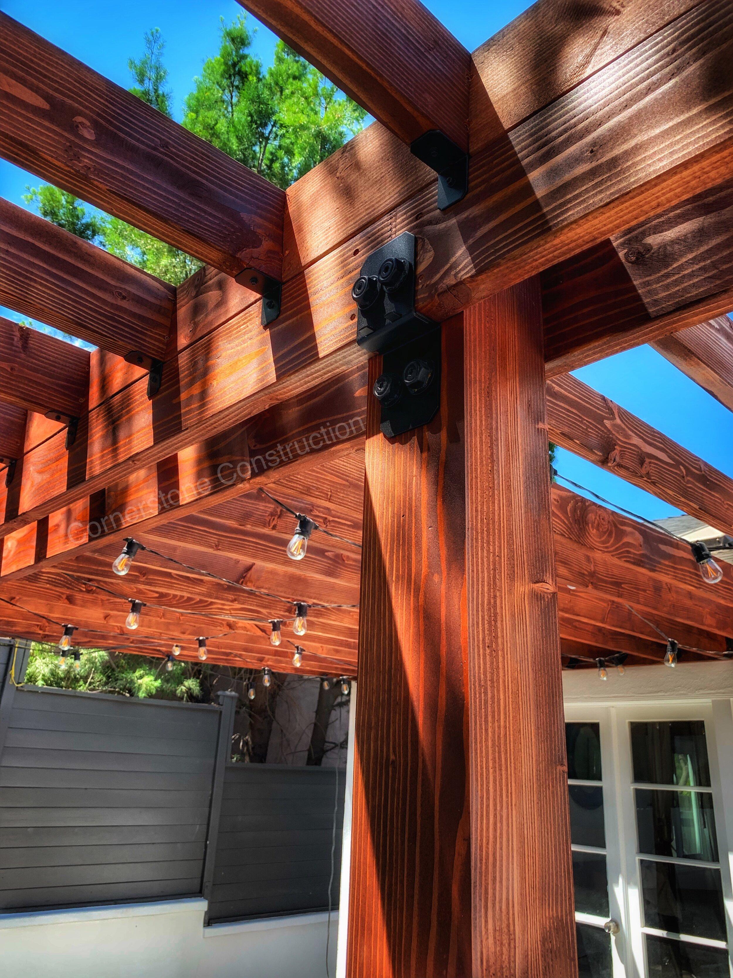 redwood pergola with Edison bulbs