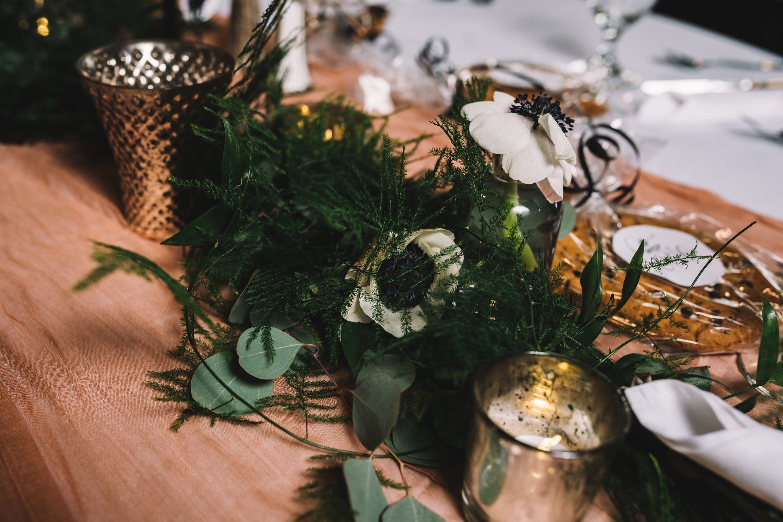 Photocredit: Shannon Gray            Garlands are a great option for couples looking for a soft, natural design.