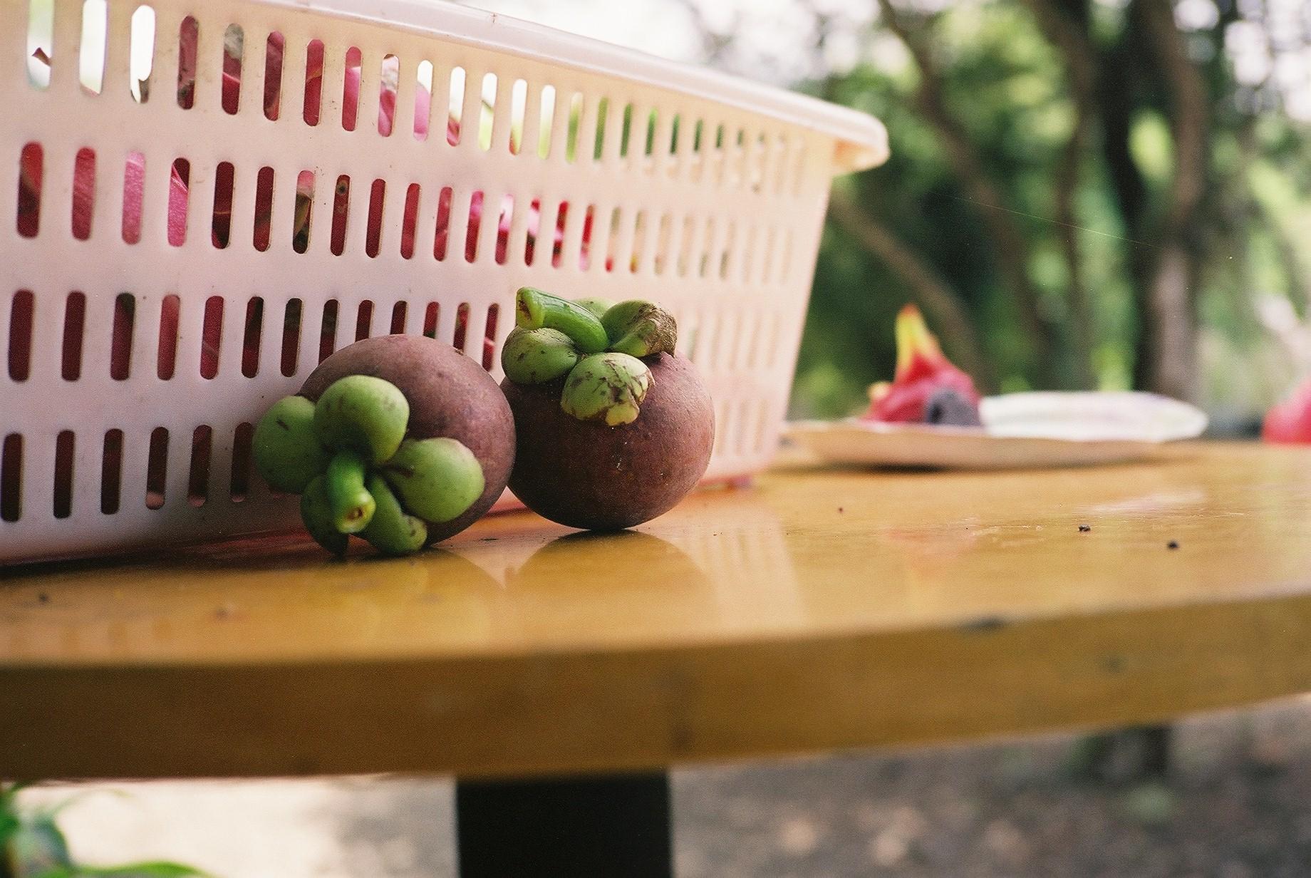 Mangosteen on table.