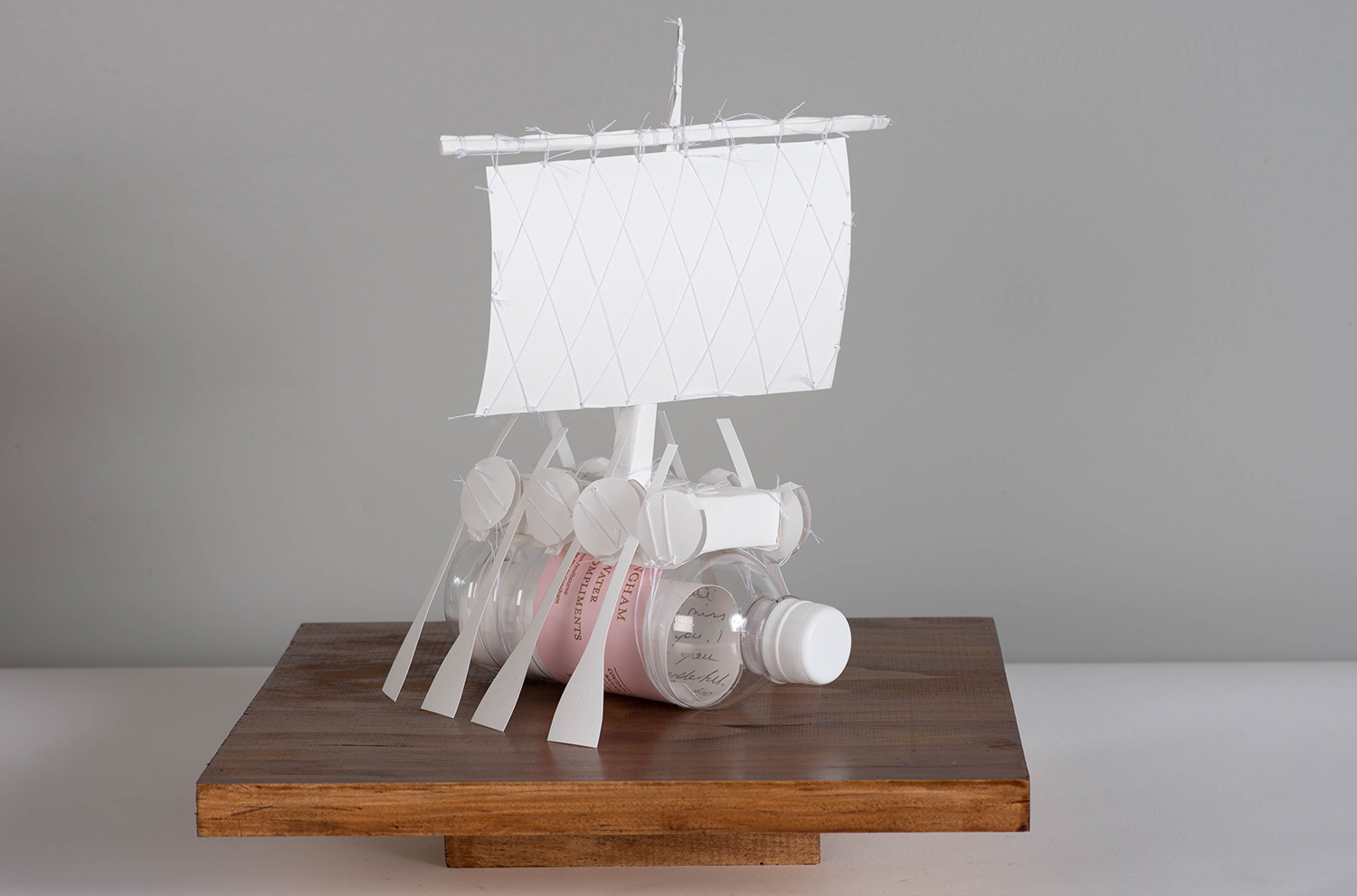 Azimuth (Langham) from Messages for my Brother, 2017, paper, thread, Langham bottle, 30 x 30 x 20 cm