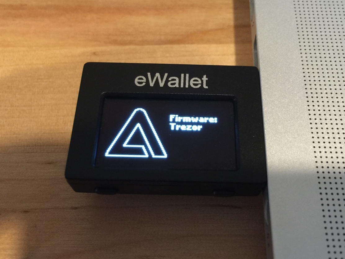 Bootloader appears to check and affirm Trezor-signed firmware images.  The button mappings are correct.