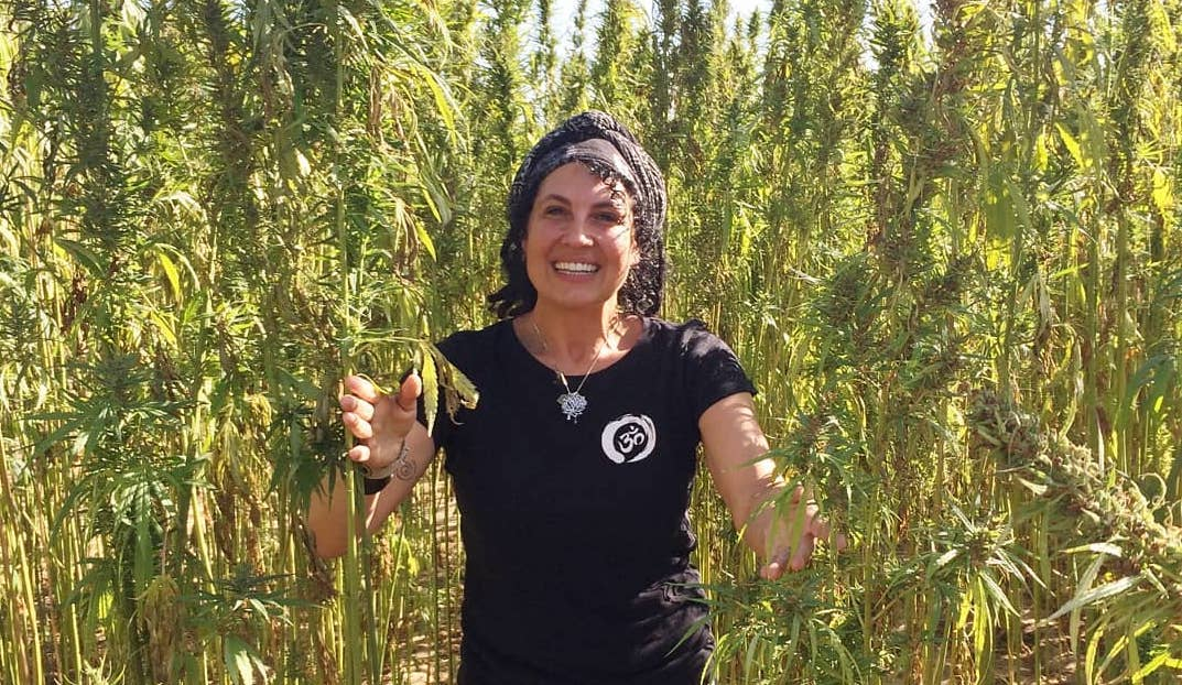 Our speaker, Joy Beckerman, standing in a field of Hemp