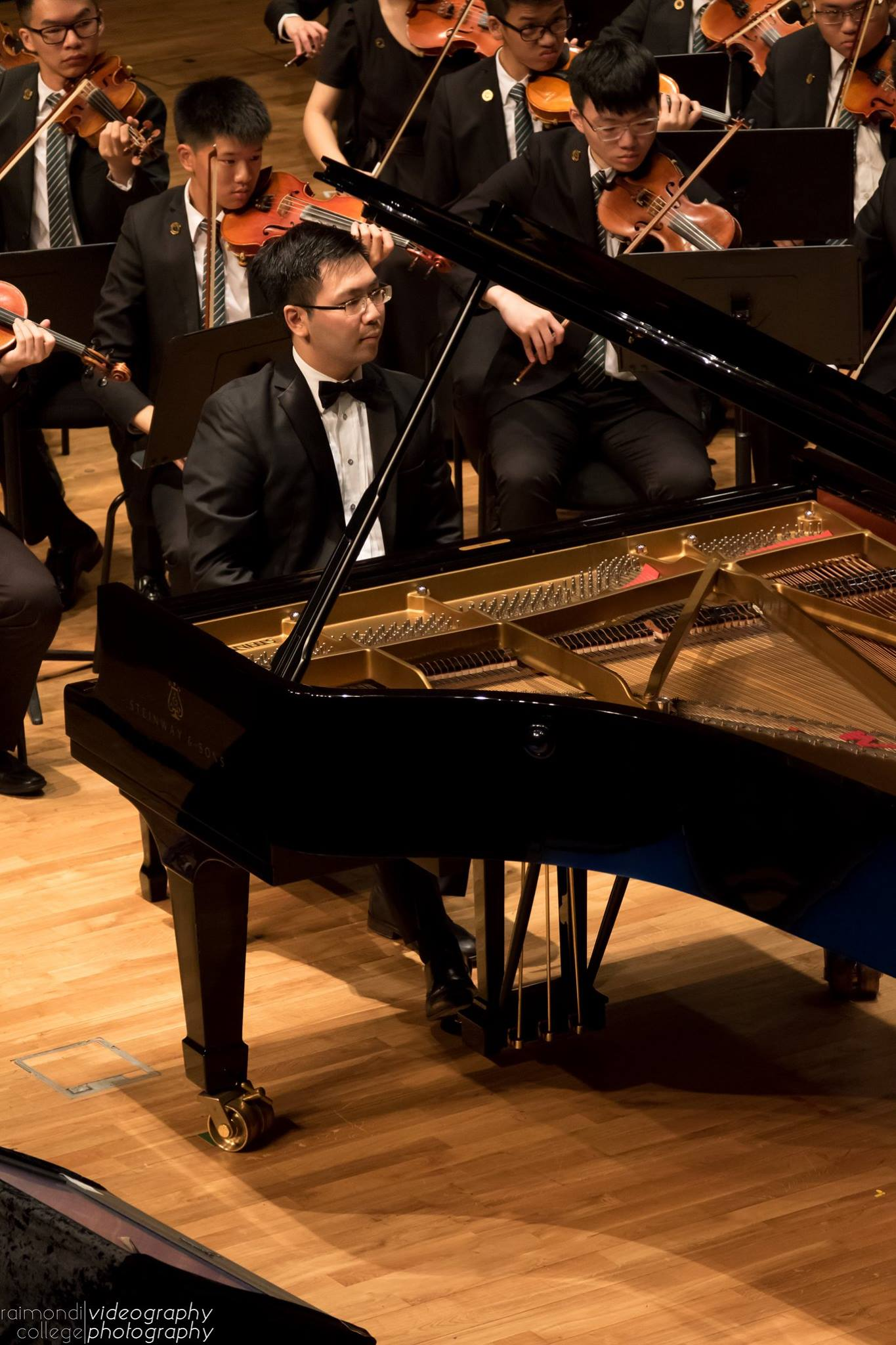 Siu Hei performing Edvard Grieg's  Piano Concerto in A minor  with the Raimondi College Orchestra in the Hong Kong City Hall Concert Hall, Hong Kong.