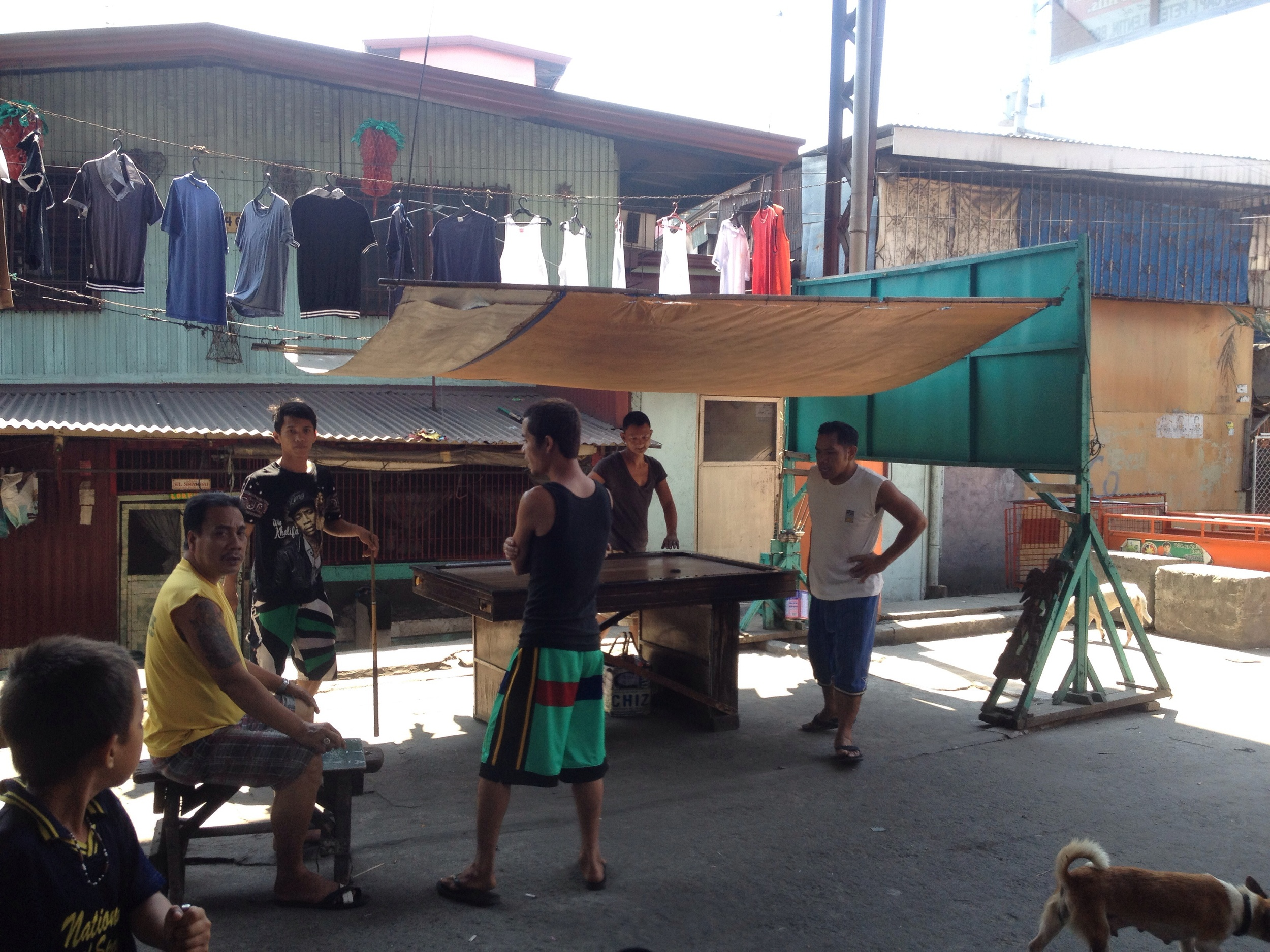 Street space is converted to a pool hall when shaded.