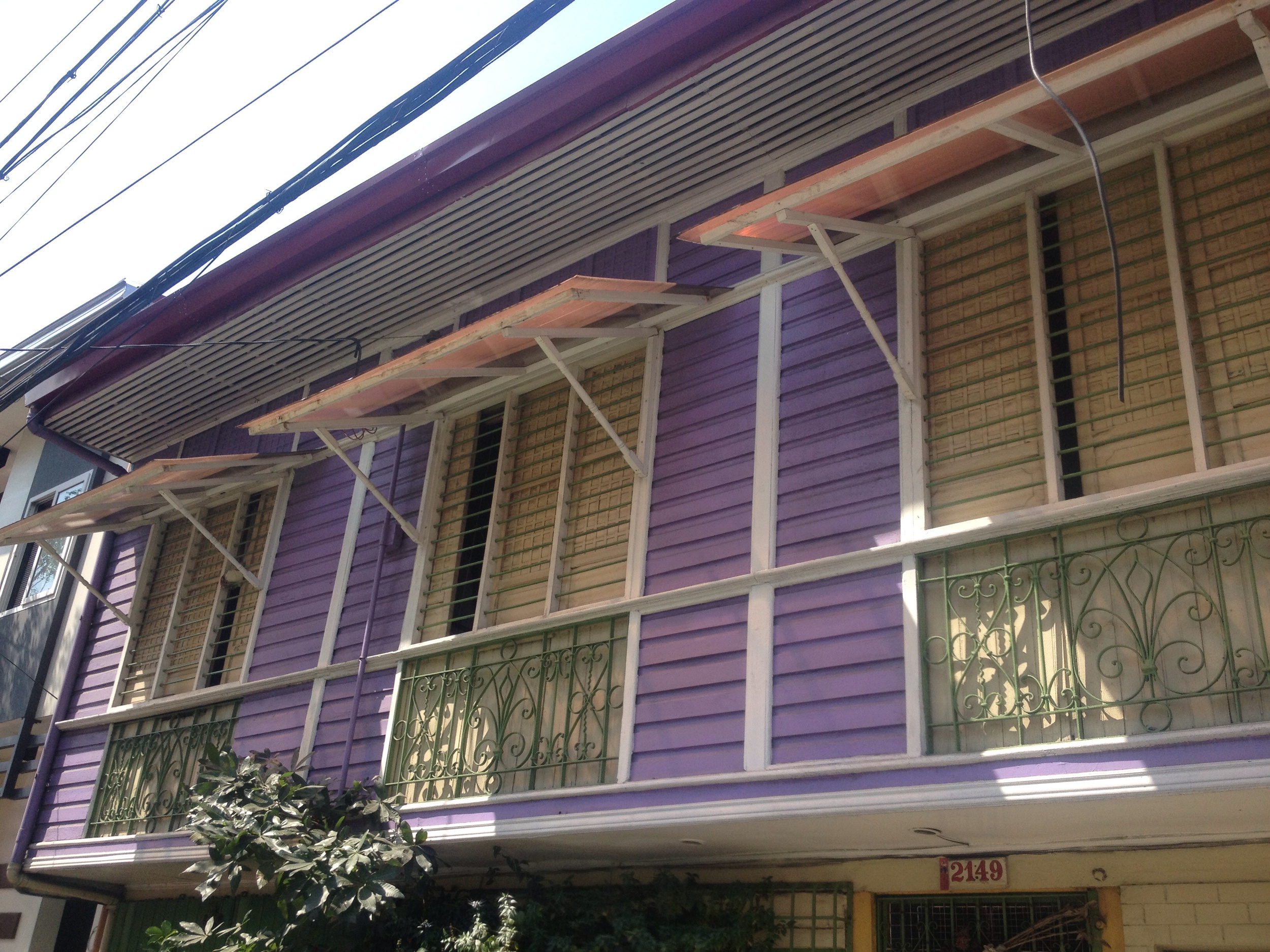 Adjustable window shades are found on heritage homes such as this one in Navotas.