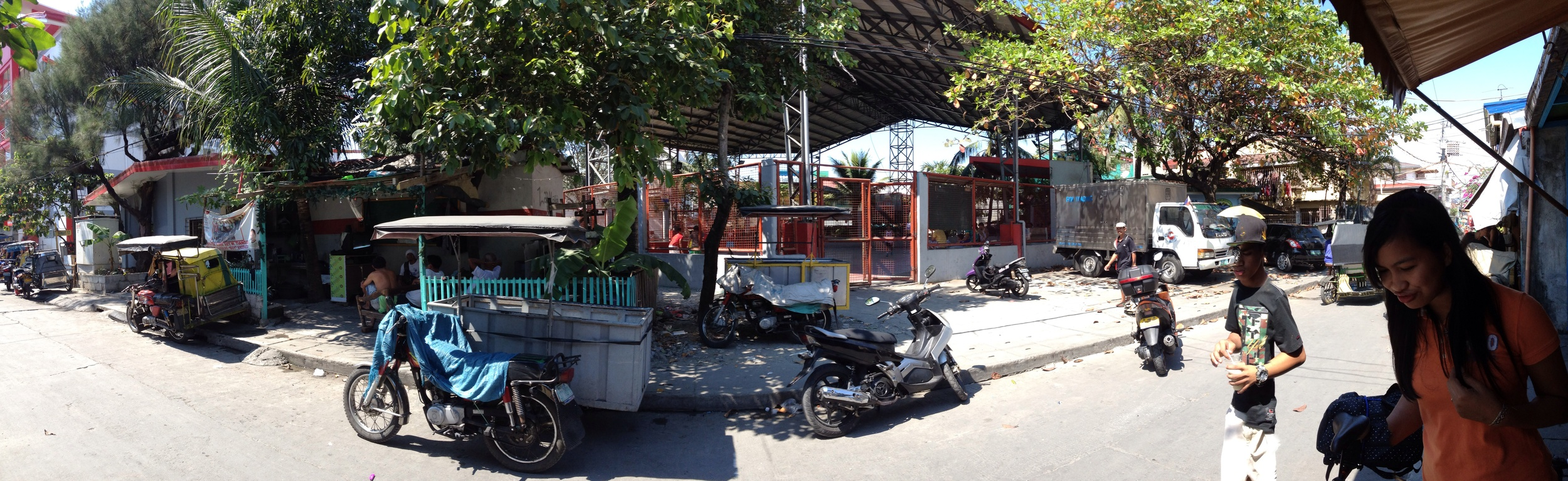 From left to right: barangay hall, tricycle association office, basketball court, day care center