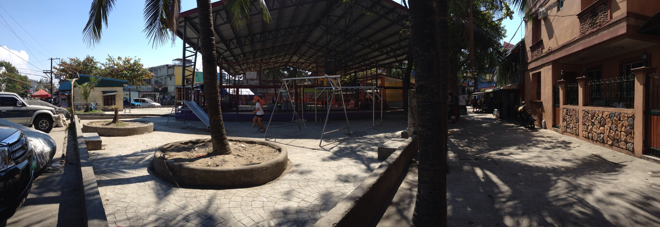 From left to right: barangay hall, basketball court, playground, general open space