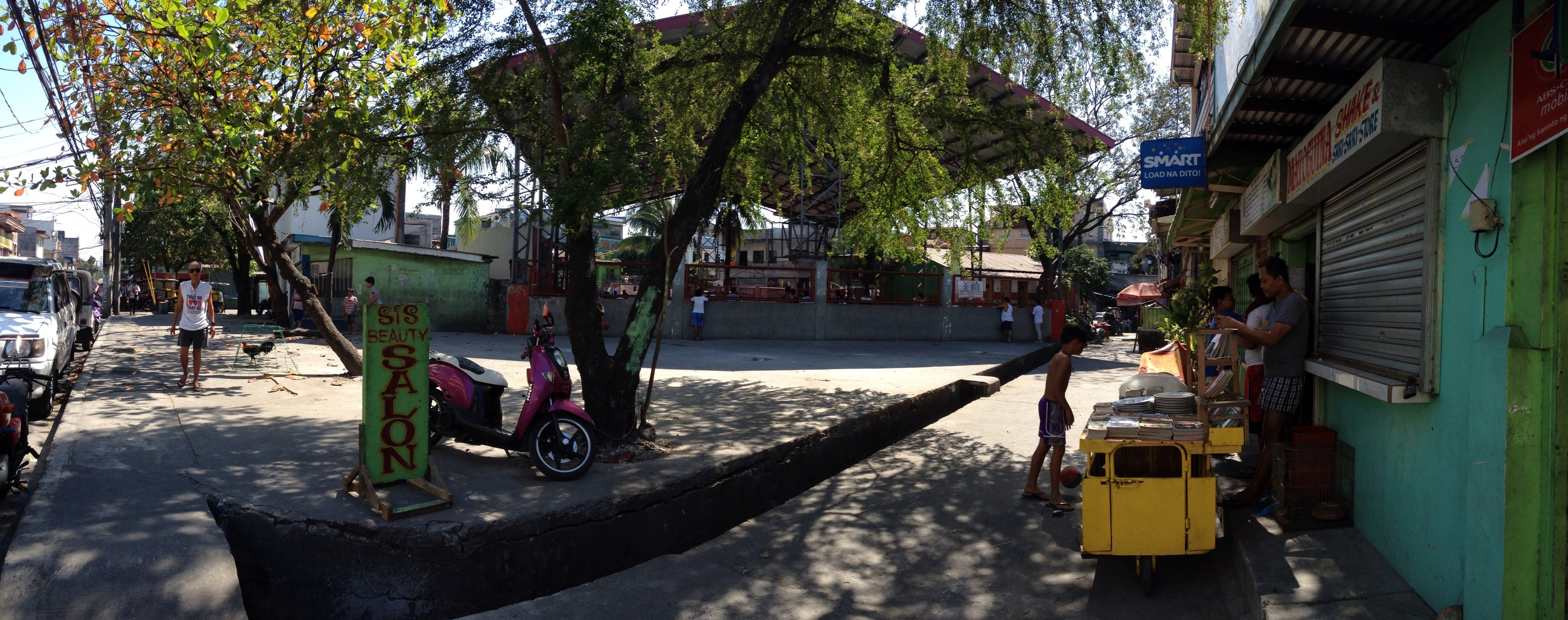 From left to right: barangay hall, basketball court, open space, local shops