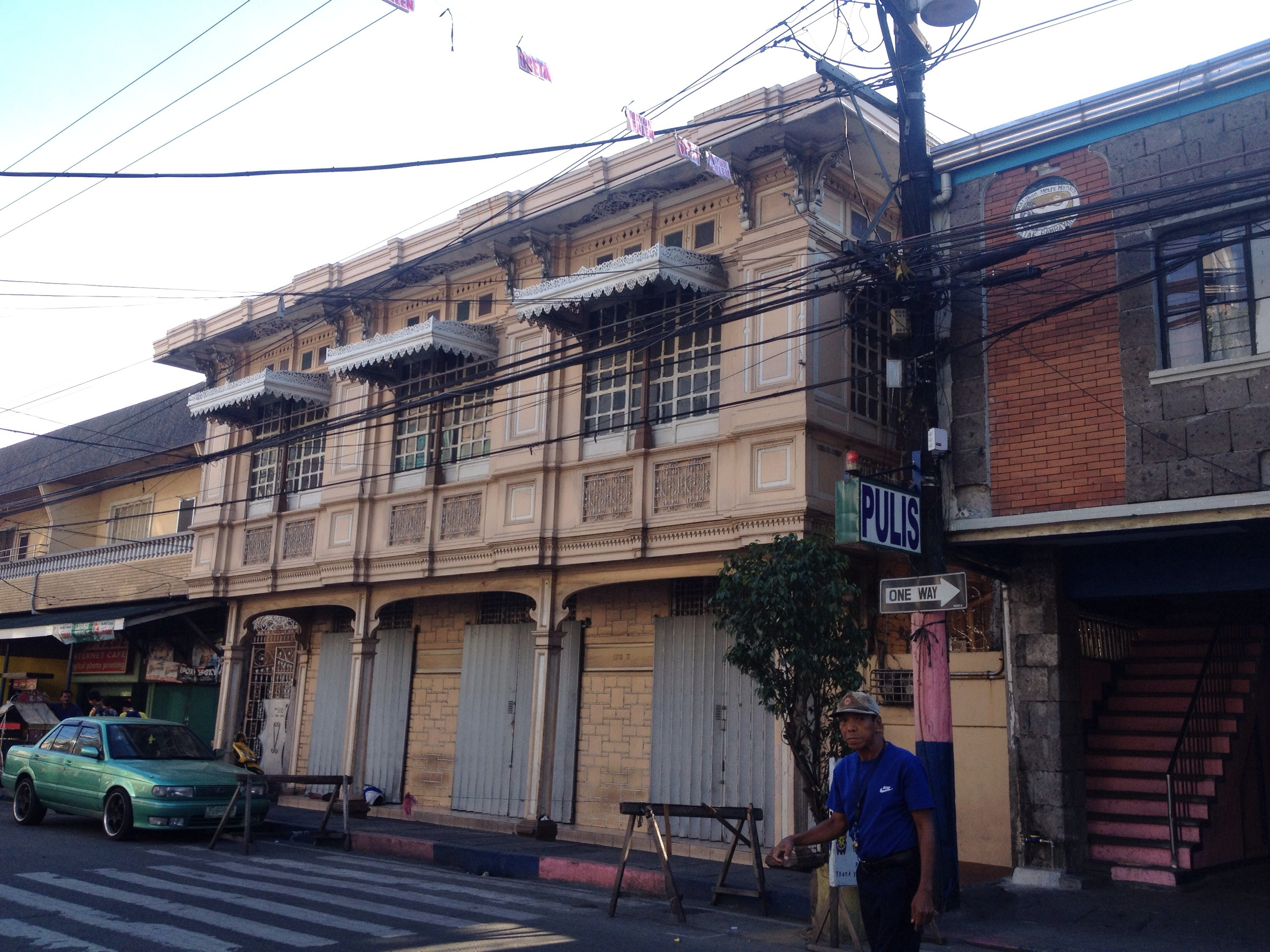 Another heritage home on General Luna St. This one seems to be well preserved. I will have to come back to see what stores are on the first floor. If tourism takes hold here the ground floor shops would make great souvenir shops since it is across the street from the Church of theImmaculate Conception. Next store is the Barangay hall and a basketball court. The two lane streets are already quite bikable, but the city could think about putting in bike racks in this area since there is a cluster of uses.