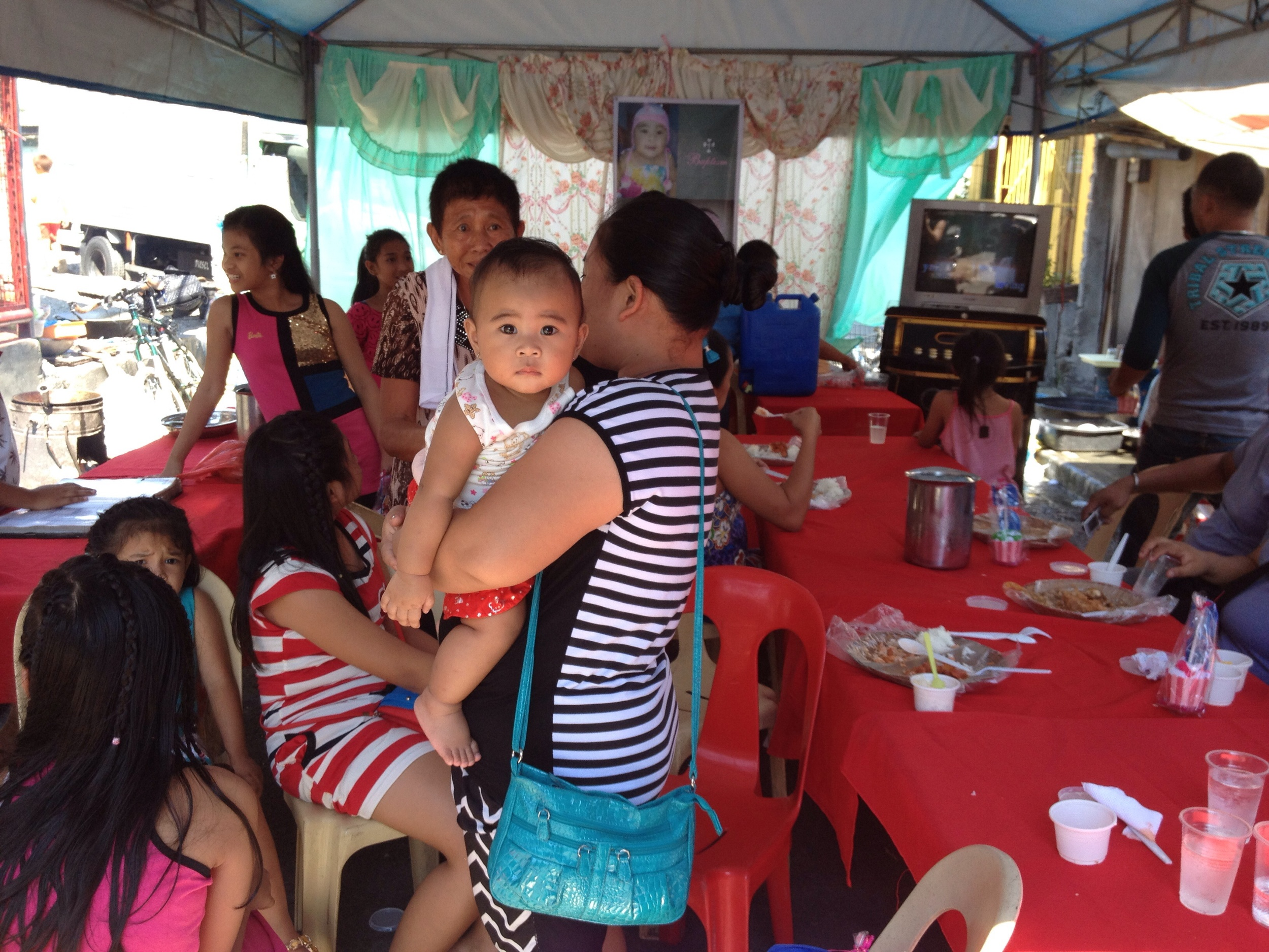 I was invited inside and offered food from the buffet and a chance to sing karaoke with guests for this baby's baptism celebration.