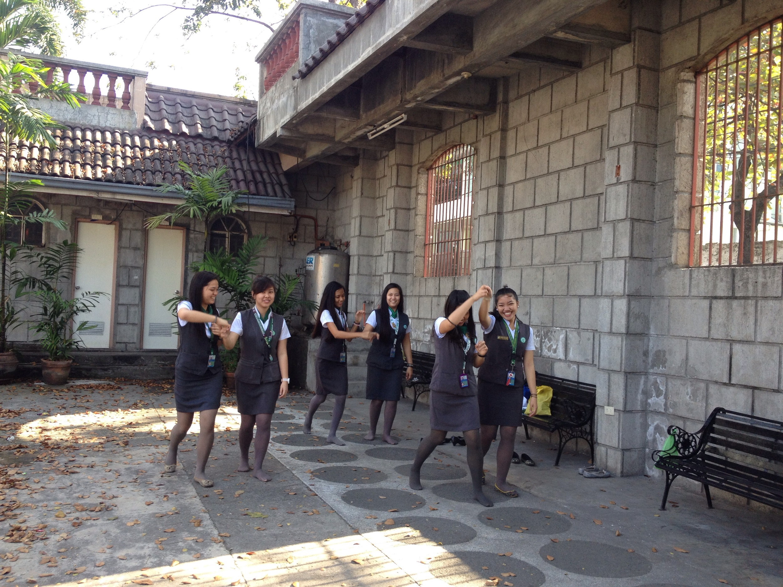 The courtyard outside the museum is used by local students to practice dance moves for a school event.