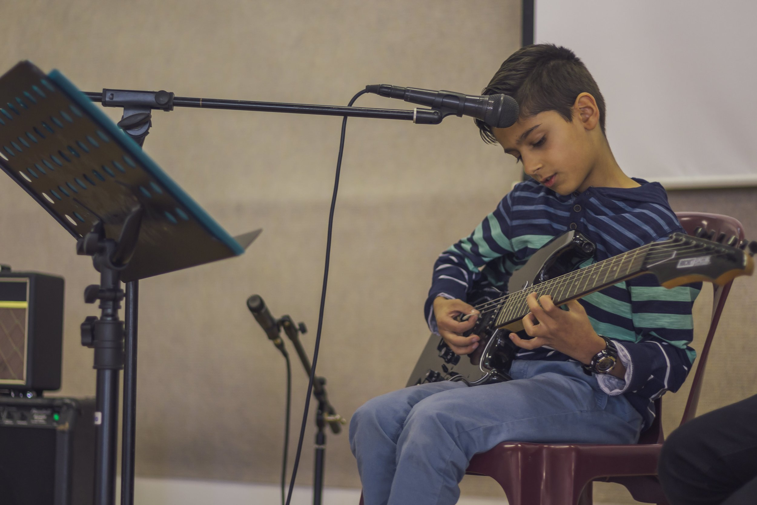 Guitar and singing student Joshua performs Cat Stevens - Father And Son
