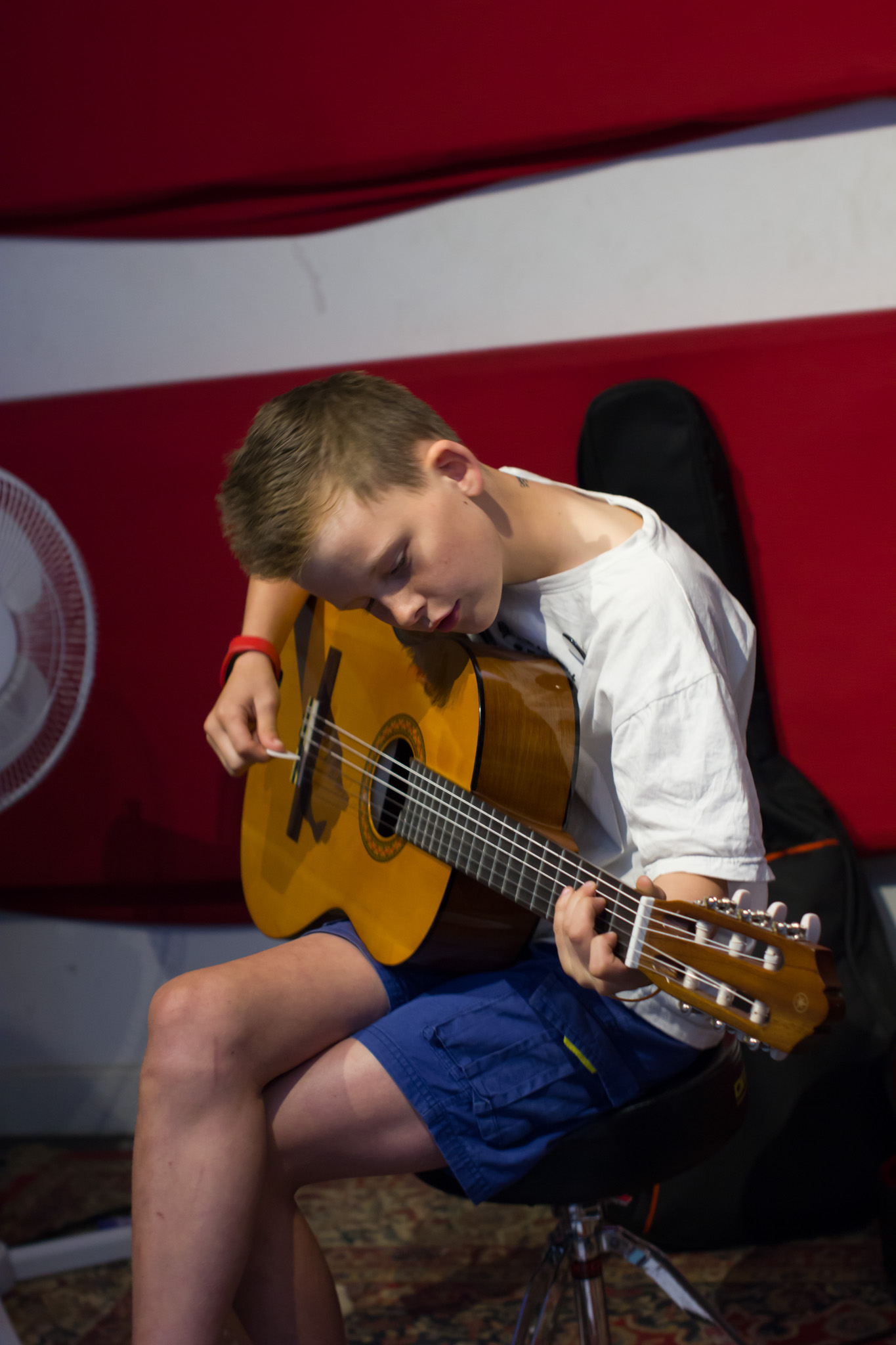 Ben playing his guitar during his group guitar lesson in Melbourne, Australia