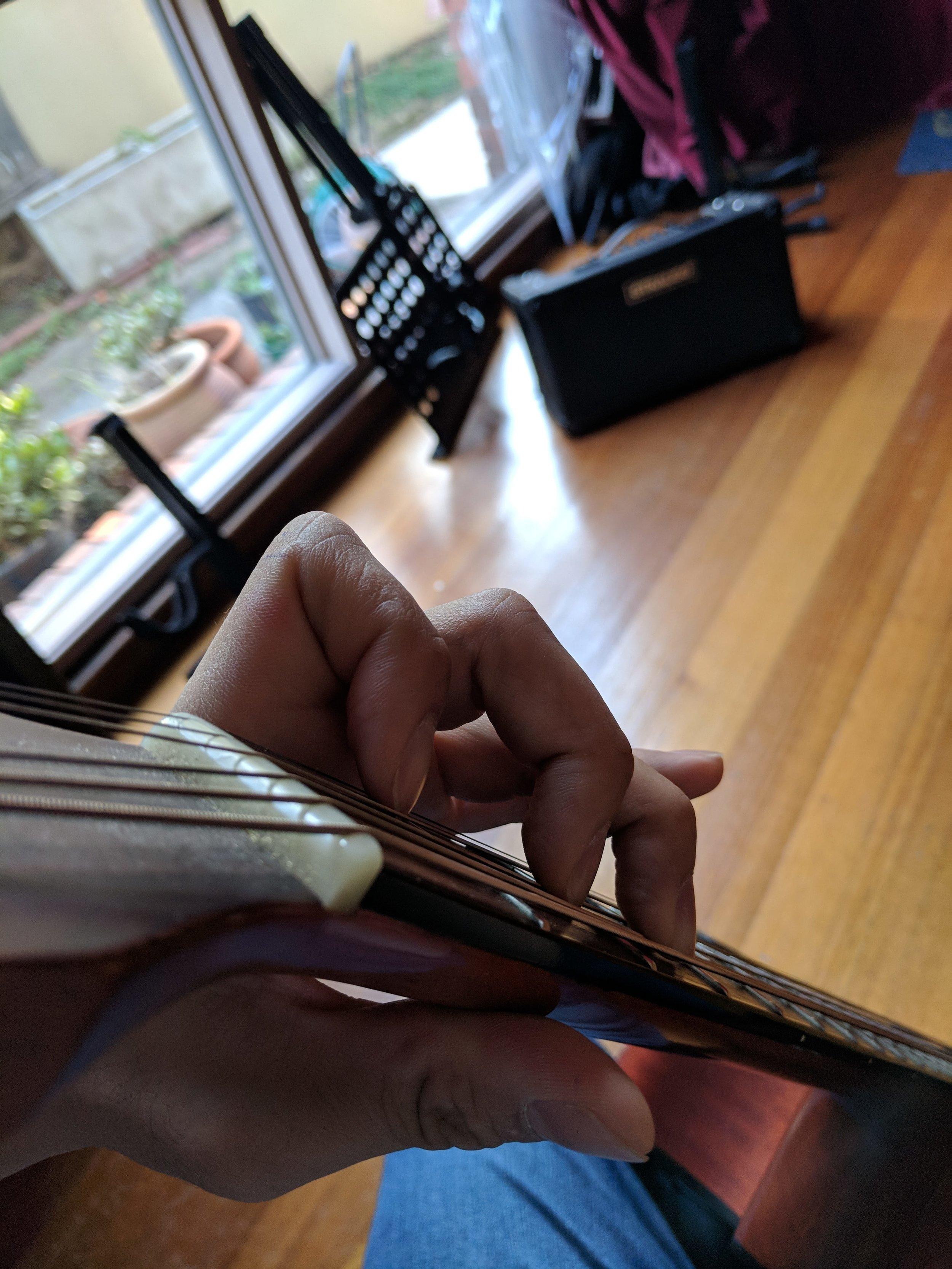 For normal fretting - the thumb at the back of the neck is a good option. For guitar bends, you may like to put your thumb over the neck - but still remain parallel. Curl your wrists to leave a strong gap - this prevents palm muting by your fretting hand.