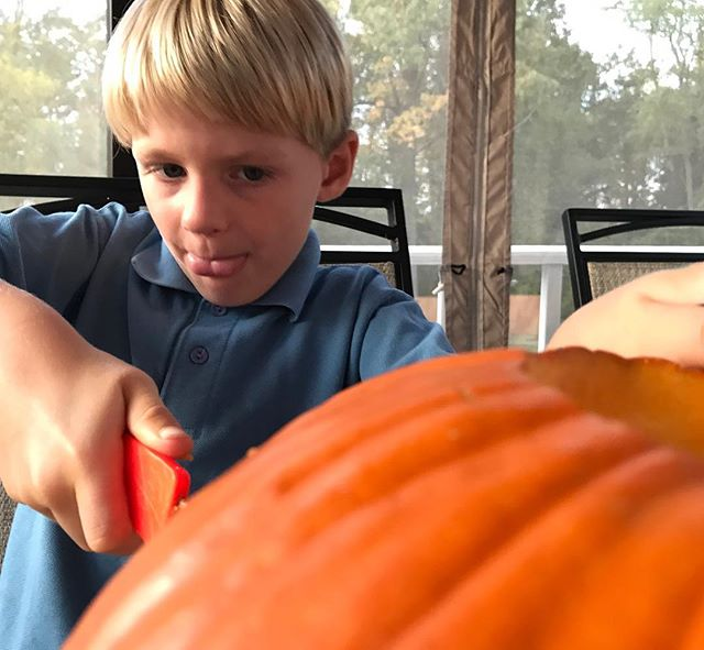 Fighting with the #pumpkin. Determined to get it carved.  #Fall in #connecticut. #halloween