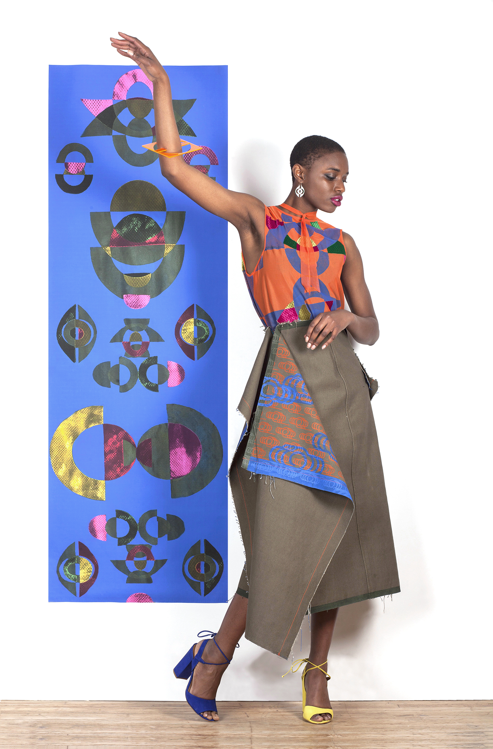 Block Printed and Velvet Appliqué Mesh Dress under a Block and Screen Printed Canvas Skirt with Laser Cut Earrings and Bracelett