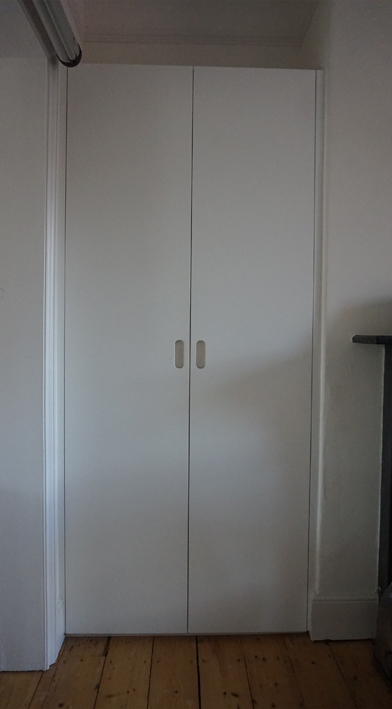 Fitted cupboard - White sprayed finish cupboard