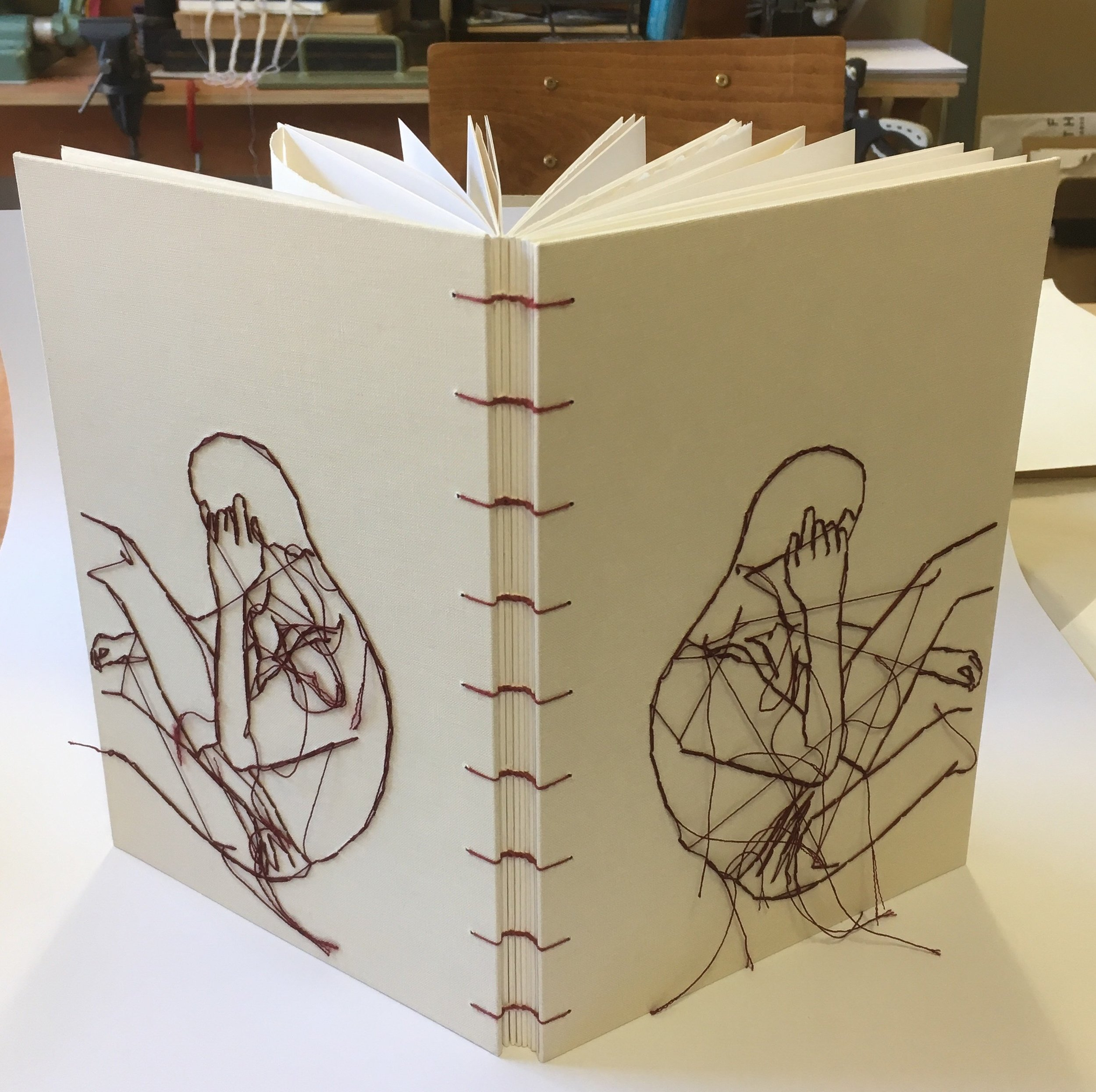 - The project involved creating a coptic binding (link stitch) with burgundy thread and using a bookcloth covering material that he was going to embroidered for the covers.Here is the bespoke book when finished.