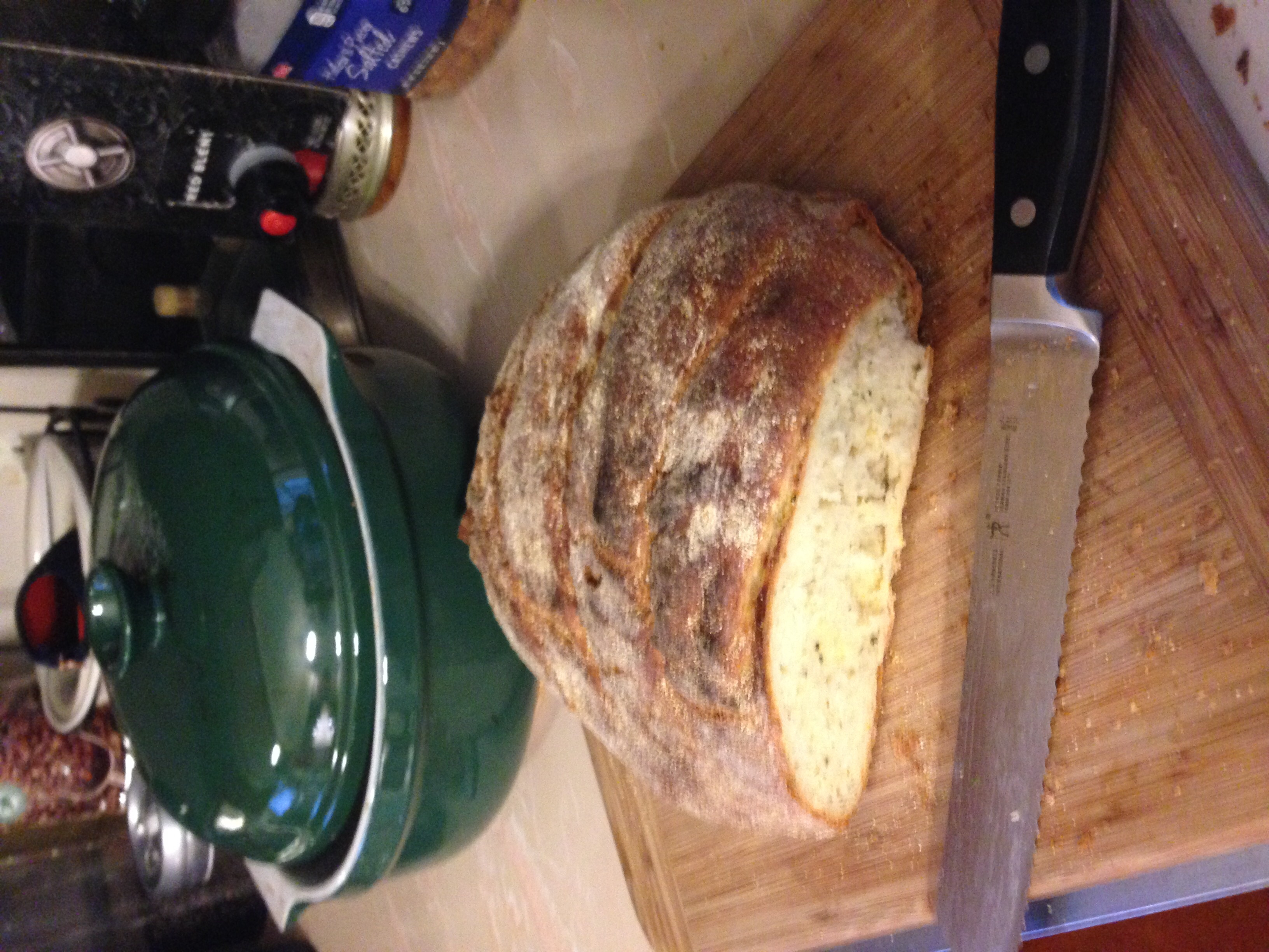 Rosemary Boule made with fresh rosemary from our garden. In the background is my Emile Henry ceramic Dutch oven, which makes a great crusty bread. I never knew a dutch oven could be used for bread making.