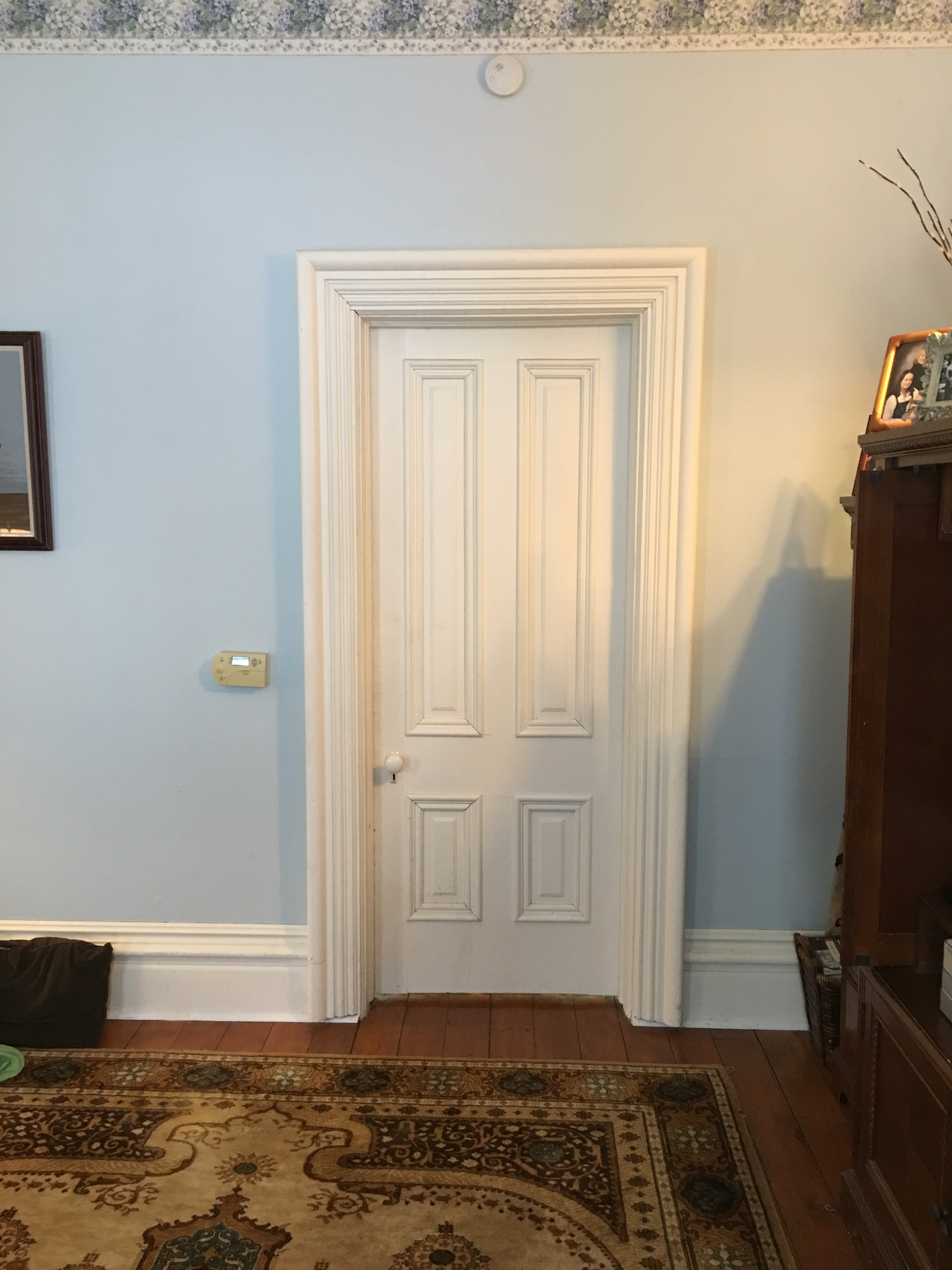 This is a door in the living room - note the way the surround builds out all the way to the outside edge...