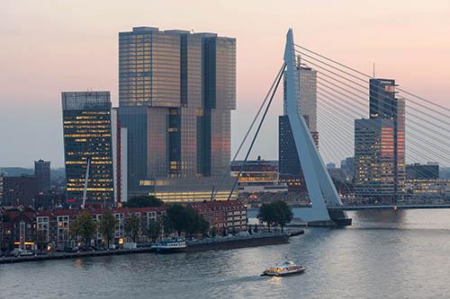 Port City Rotterdam      - 'The Rotterdam' building by OMA (Rem Koolhaas)         - Erasmus Bridge by UNSTUDIO (Ben van Berkel)