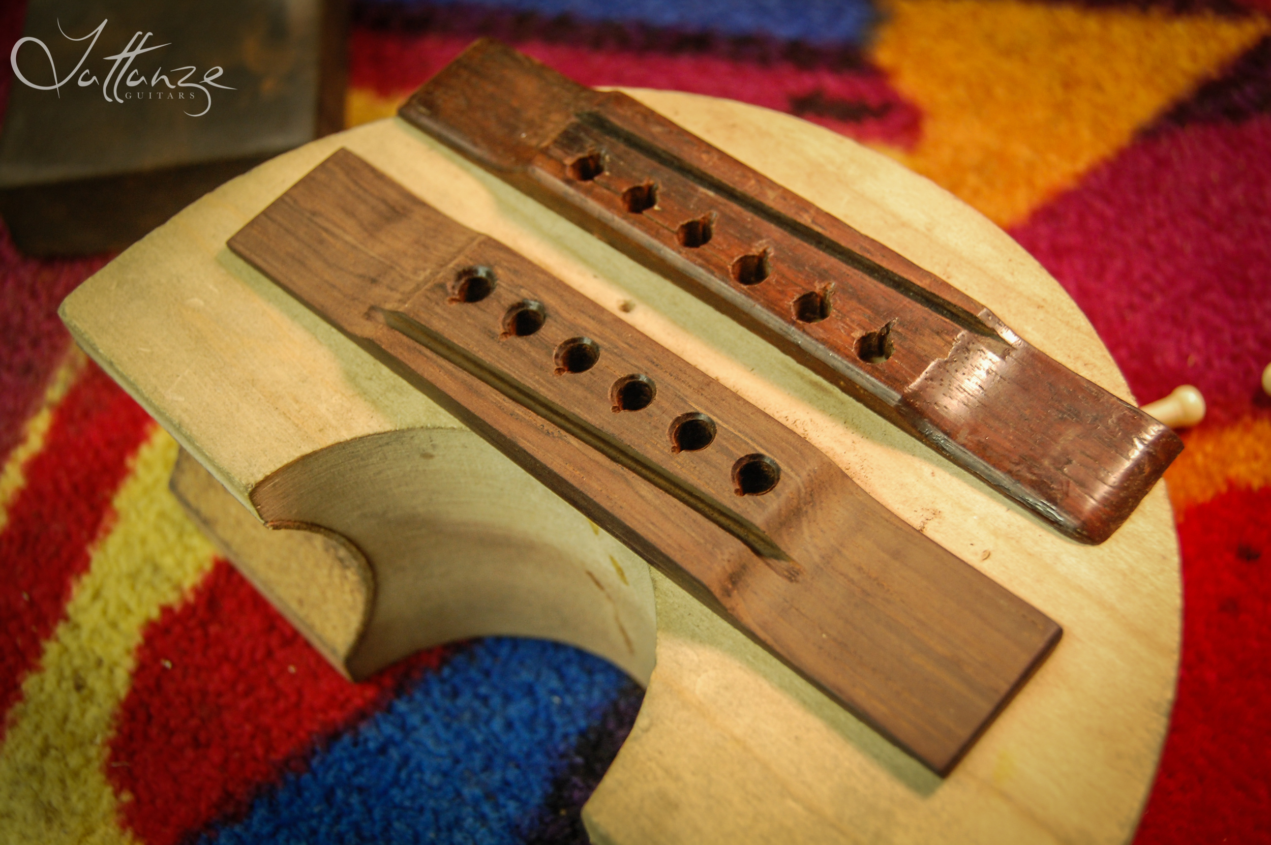 Sandeing the new bridge made from Brazilian Rosewood