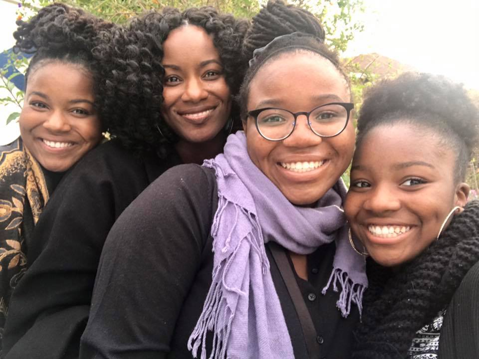 The Tomlinson family from left: OIYC alum Aliah, mother Leatrice, Saaniyah, and OIYC member Niara