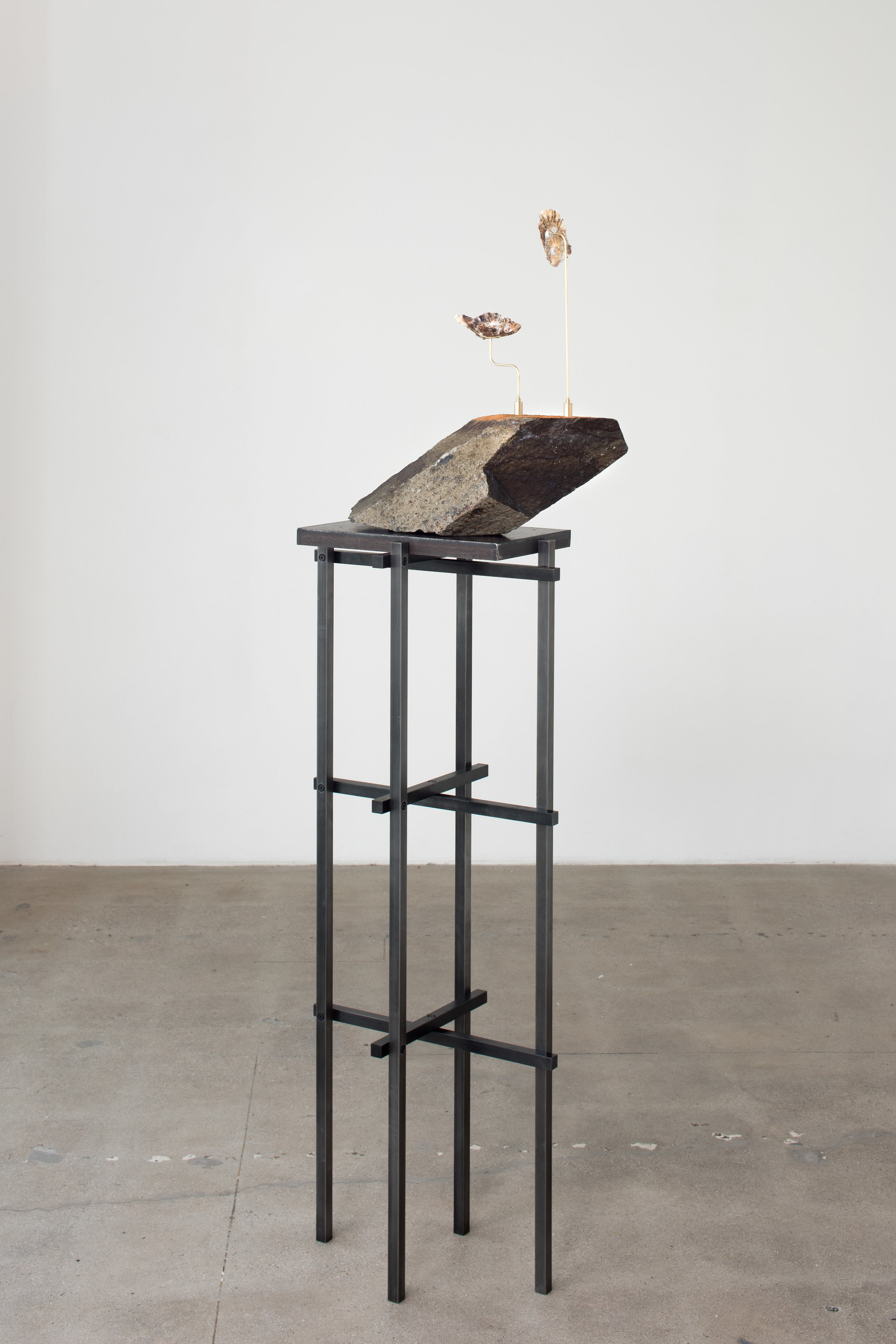 Stone Rafts Floating In A Sea of Magma , 2018 Steel, basalt, brass, oyster shells, and hardware 63 1/2 x 20 x 8 3/4 inches